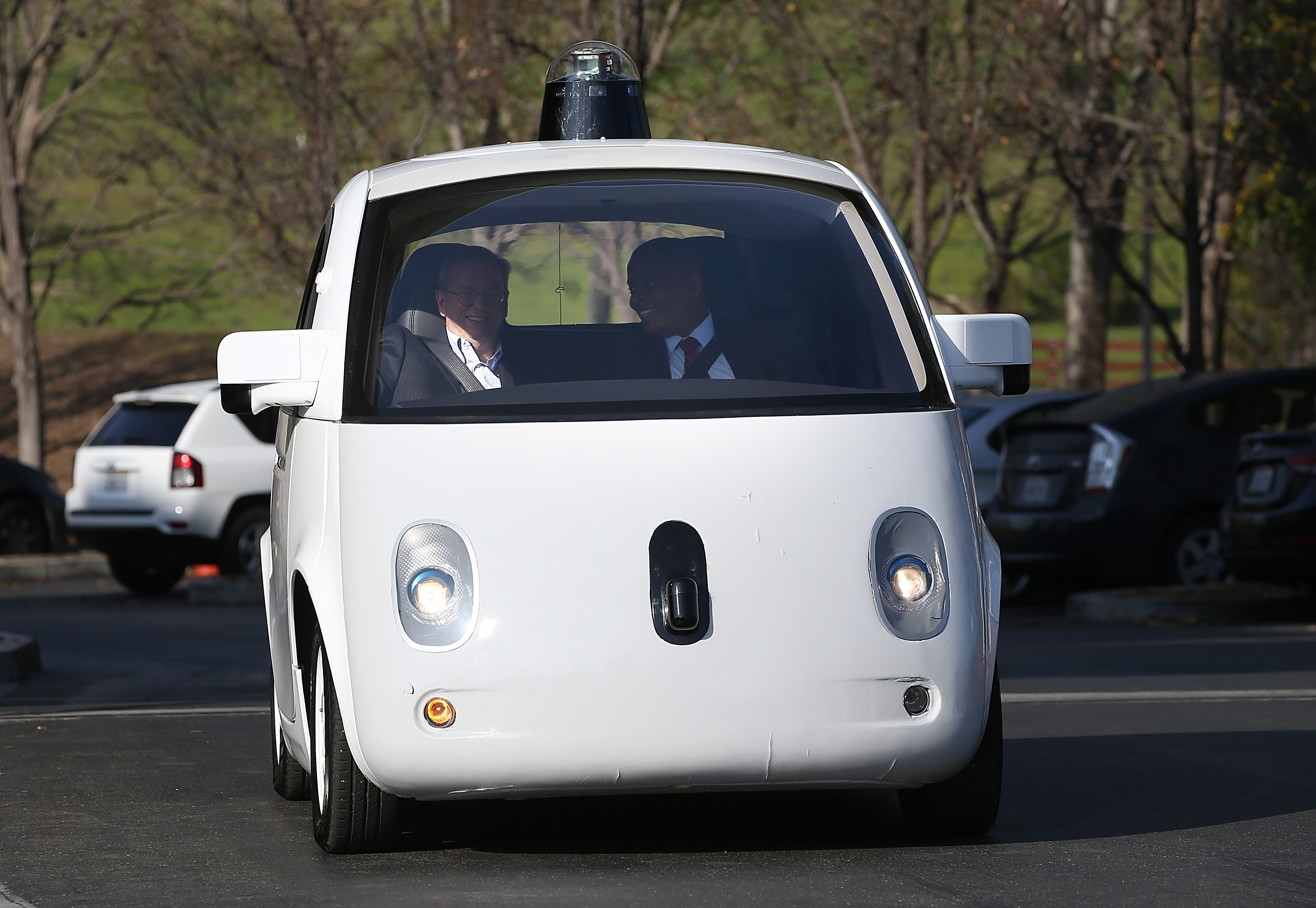 U.S. Transportation Secretary Anthony Foxx (R) and Google Chairman Eric Schmidt (L) ride in a Google self-driving car at the Google headquarters on Feb. 2, 2015 in Mountain View, California.