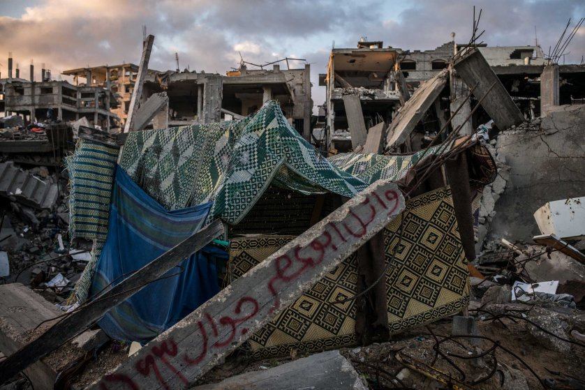 A destroyed building in Shejaiya, Gaza. Families have written their names on the rumbles that once were their homes. December 2014.