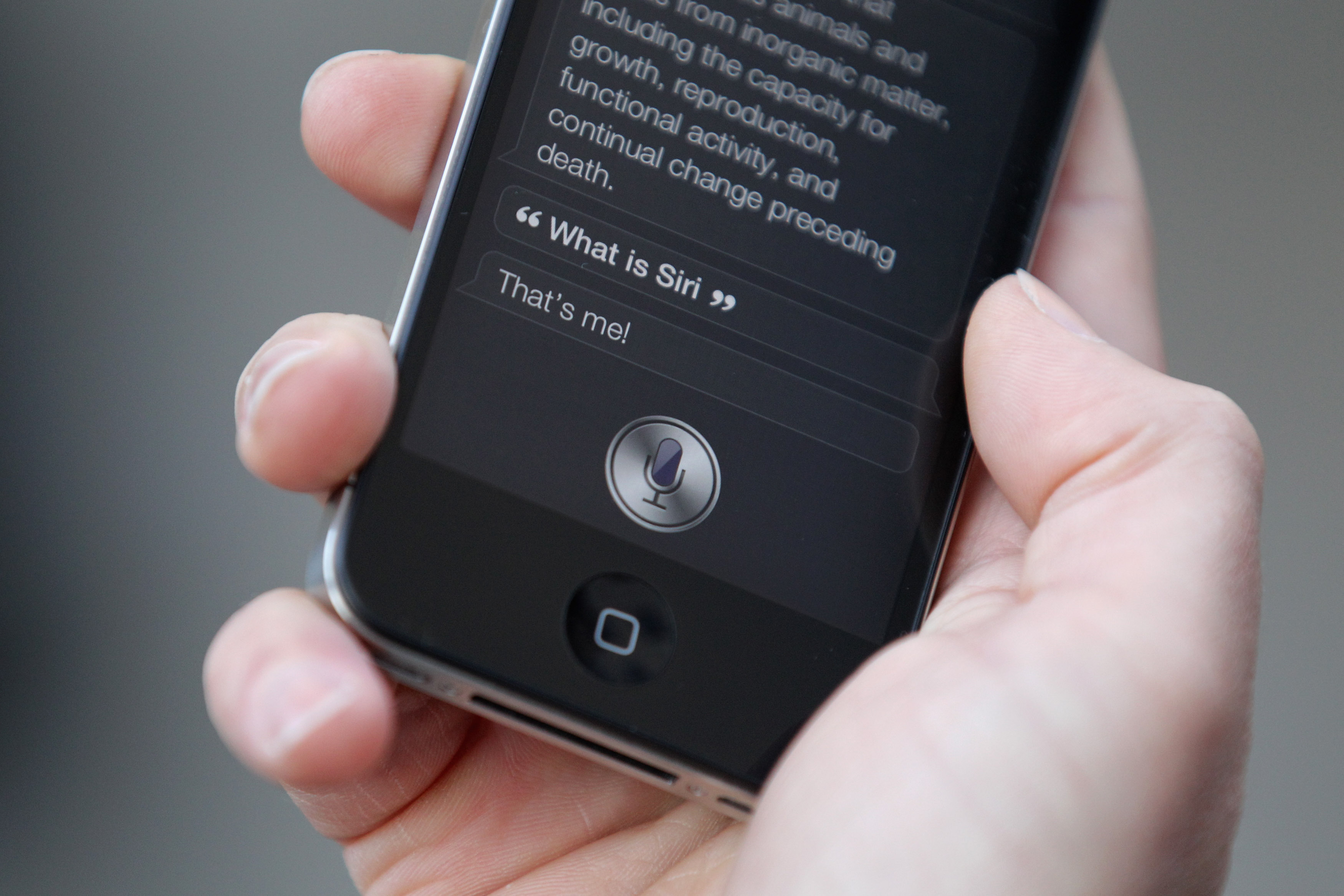 A man uses 'Siri' on the new iPhone 4S in Covent Garden on Oct.14, 2011 in London, England.