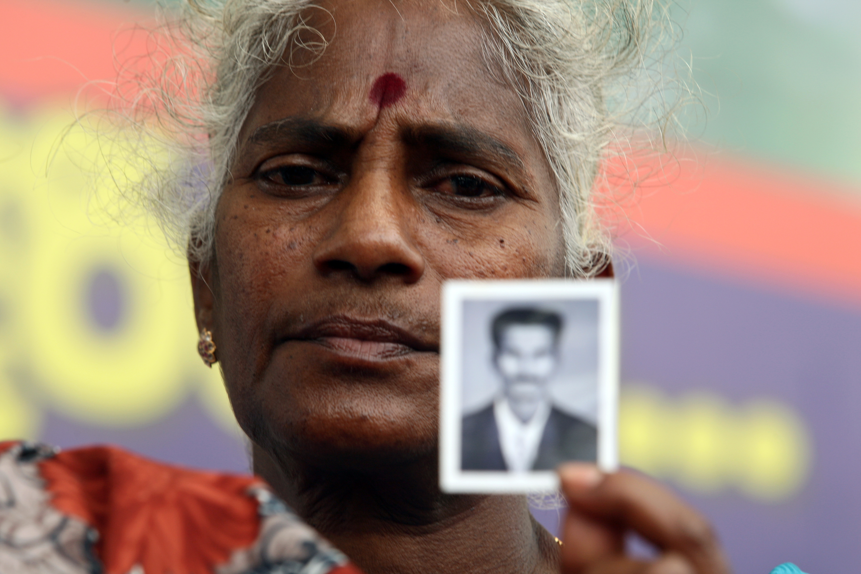 Senevirathnam Wasanayagi, 63, mother of a detained Tamil Tiger rebel suspect holds up a photo of her son during a protest outside the main prison on May 29, 2012, in Colombo, Sri Lanka. Relatives and rights activists are demanding that the Tamil Tiger rebel suspects who have been held without trial  are released or brought to court
