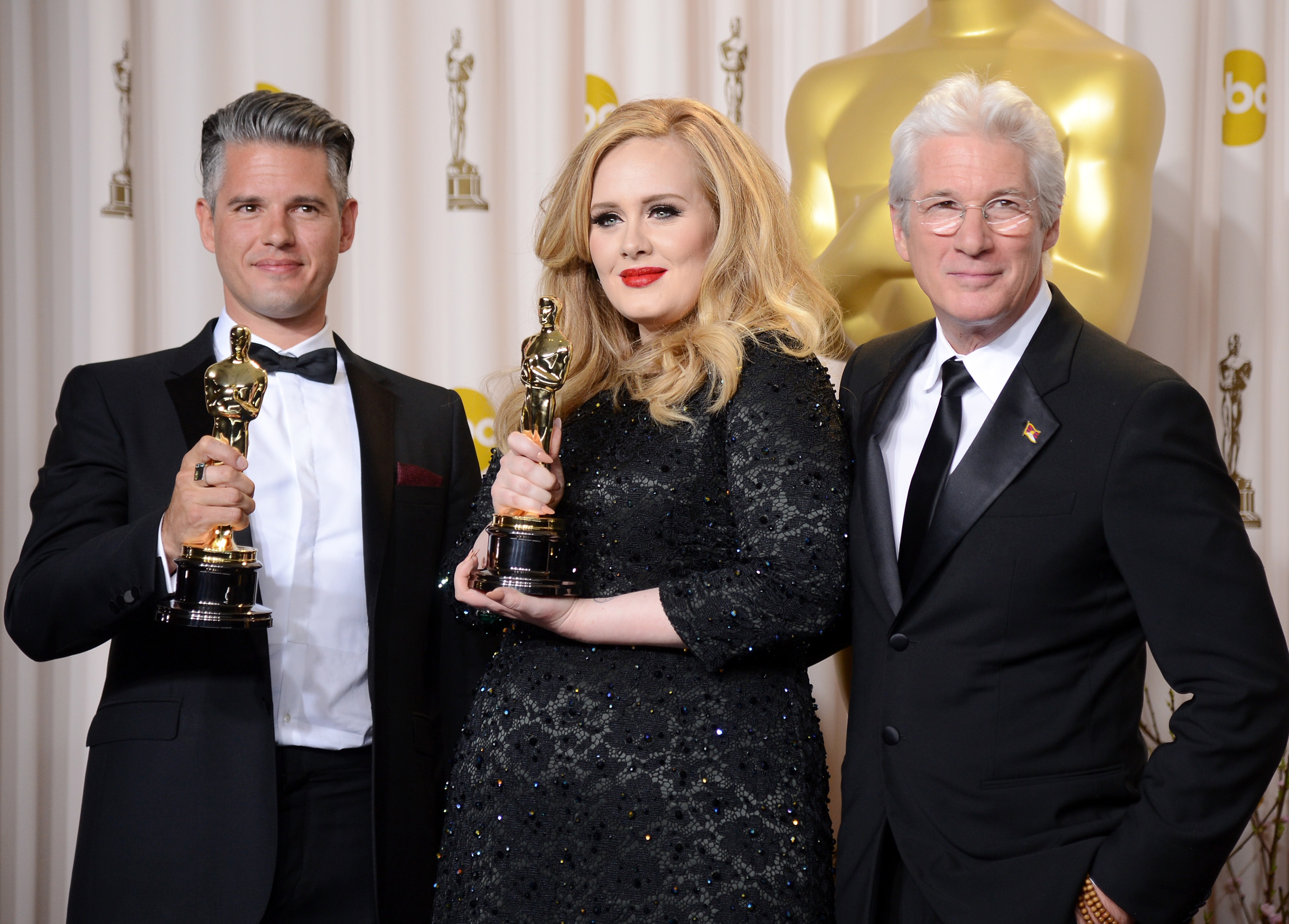 "Paul Epworth and Adele, winners of the Best Original Song award for ""Skyfall,"" pose with presenter Richard Gere pose during the Oscars at Loews Hollywood Hotel in Hollywood, on Feb. 24, 2013."