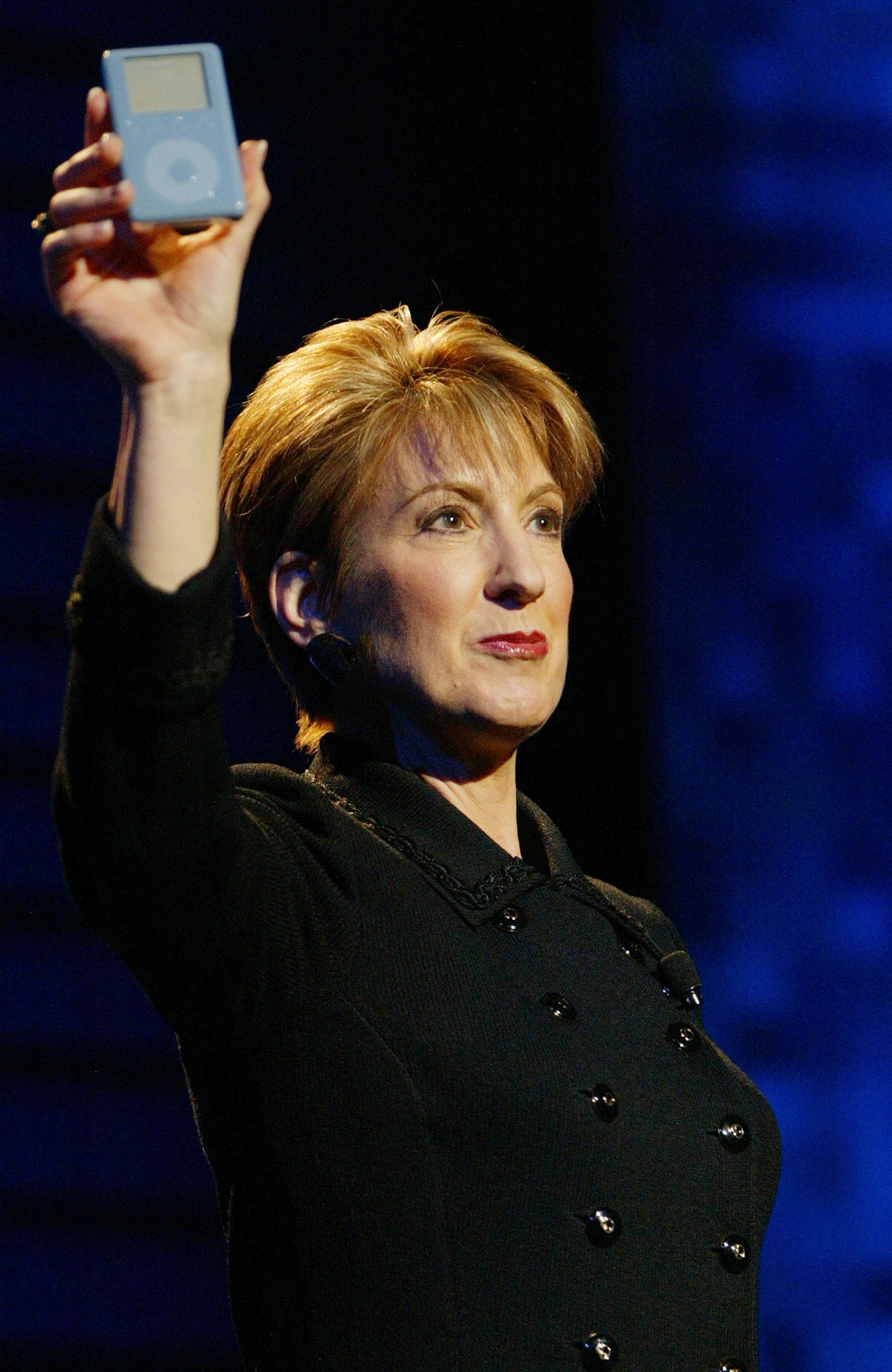 Carly Fiorina holds up an iPod as she delivers a keynote address at the International Consumer Electronics Show (CES) January 8, 2004 in Las Vegas.