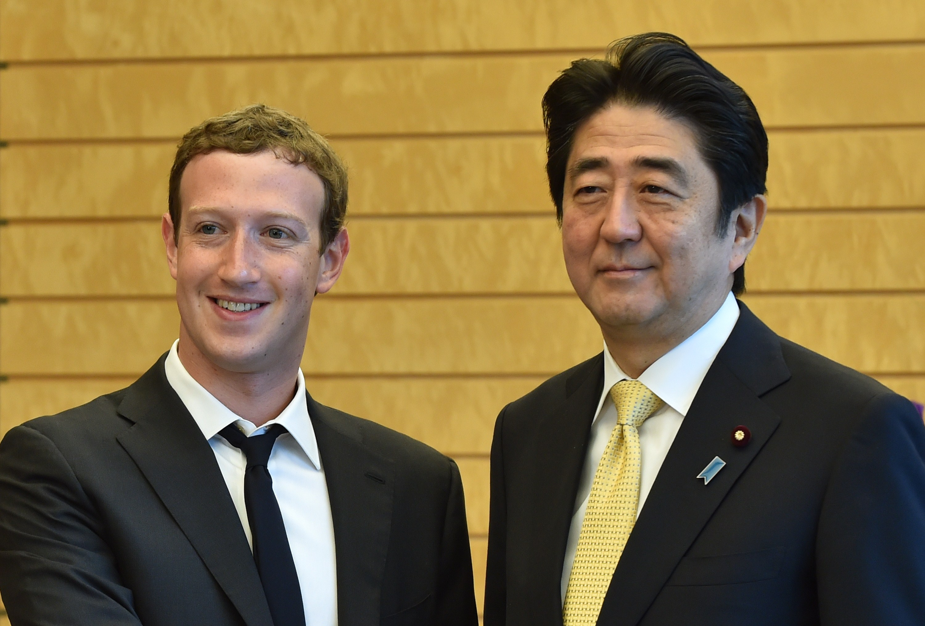 Mark Zuckerberg (L), founder and CEO of Facebook, makes a courtesy call to Japanese Prime Minister Shinzo Abe (R) at the latter's official residence in Tokyo on October 20, 2014.