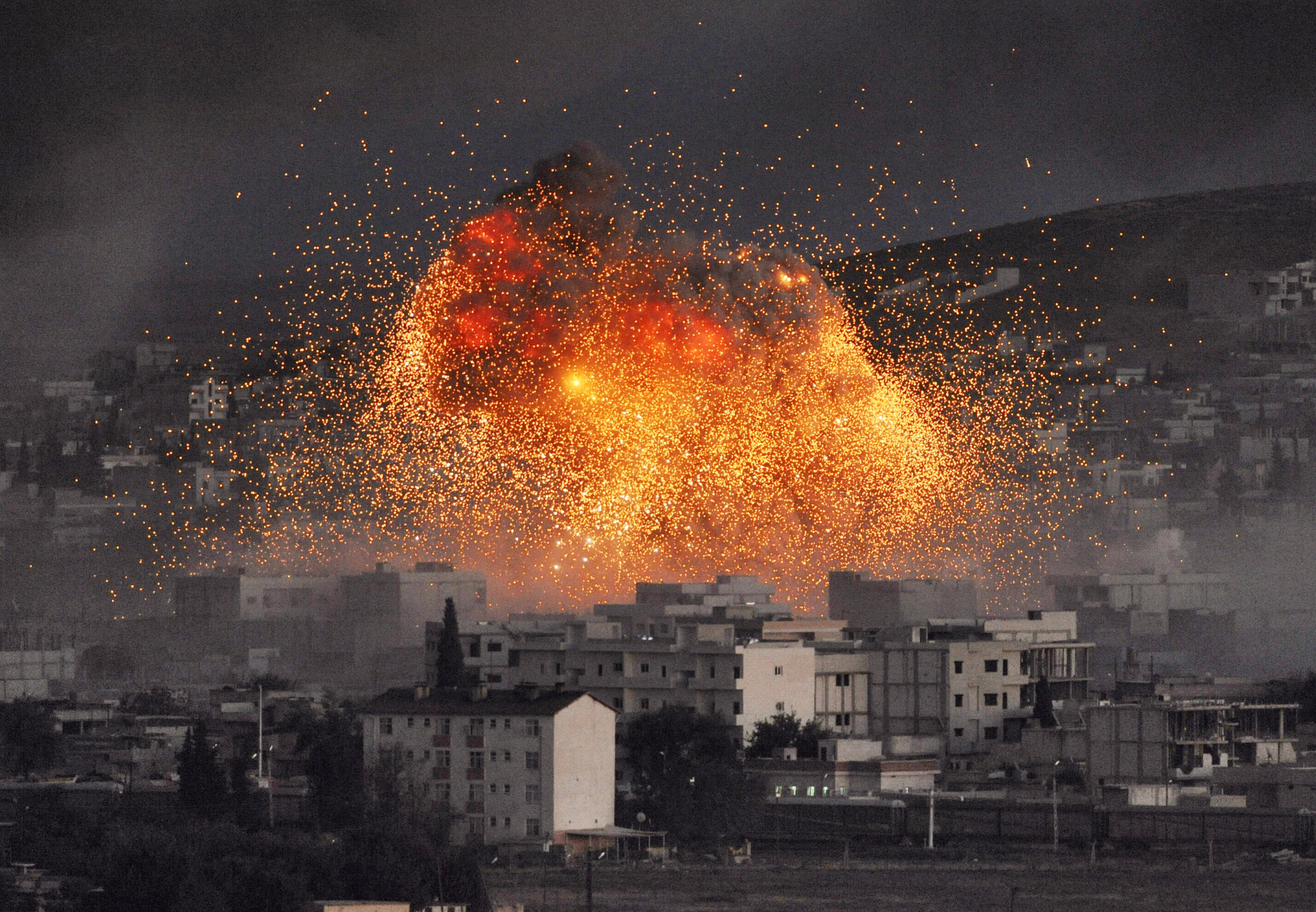 An explosion rocks Syrian city of Kobani during a reported suicide car bomb attack by the militants of Islamic State (ISIS) group on a People's Protection Unit (YPG) position on Oct .20, 2014, in Sanliurfa province, Turkey.