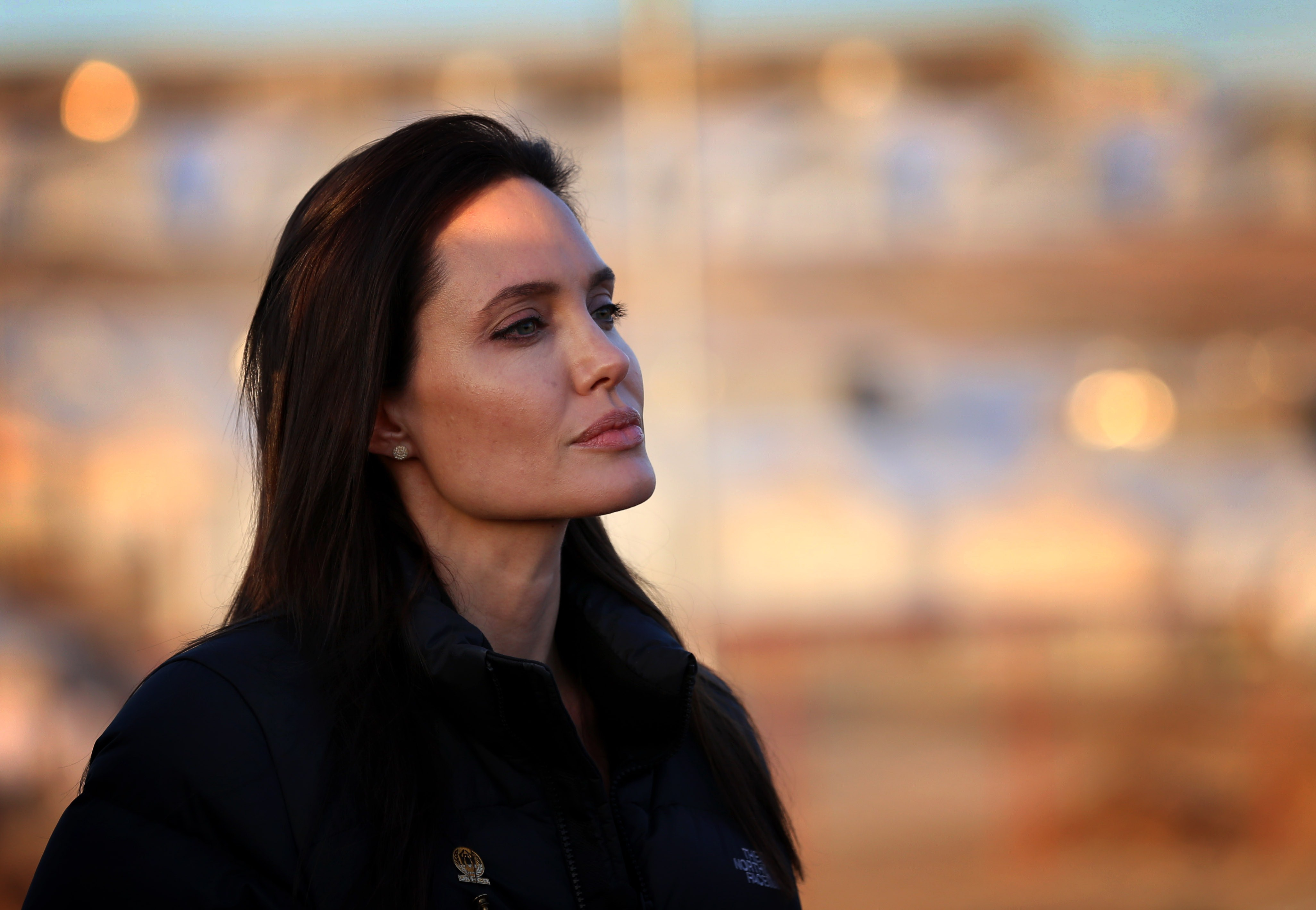 Angelina Jolie stands during a visit to a camp for displaced Iraqis in Khanke, a few miles from the Turkish border in Iraq's Dohuk province, on Jan. 25, 2015.