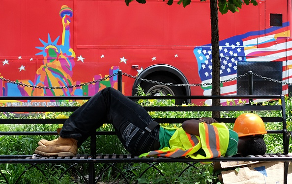 A worker takes nap on a park bench at his break during a hot summer day in New York on June 23, 2015. Last month marked the hottest May in modern history, continuing a troubling trend of rising global temperatures, according to US scientists of the National Oceanic and Atmospheric Administration (NOAA). AFP PHOTO/JEWEL SAMAD        (Photo credit should read JEWEL SAMAD/AFP/Getty Images)