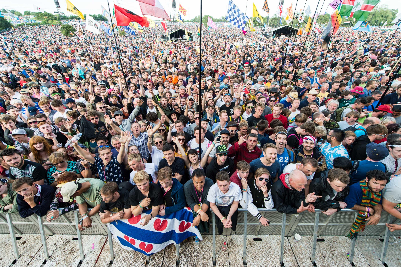 The crowd gathers at the Glastonbury Festival at Worthy Farm, Pilton on June 28, 2015 in Glastonbury, England