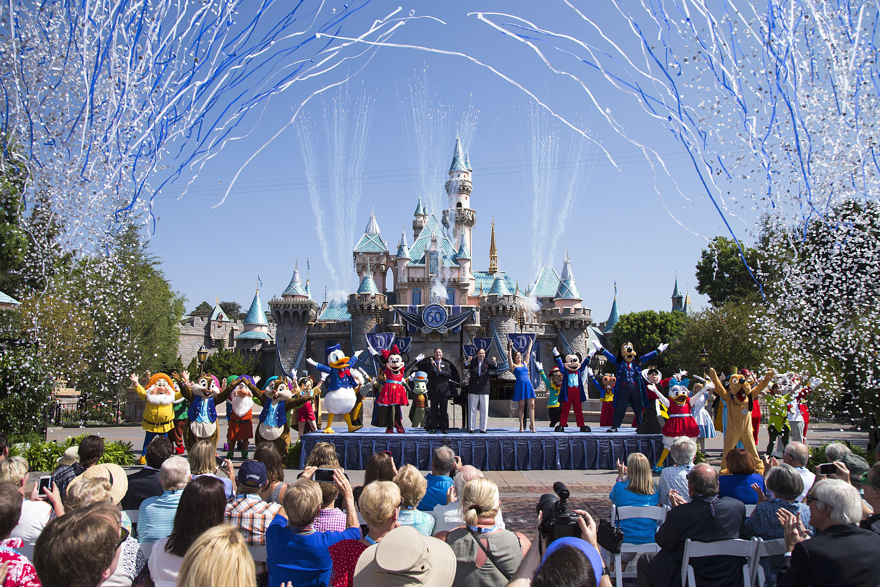 Mickey Mouse and his friends celebrate the 60th anniversary of Disneyland park during a ceremony at Sleeping Beauty Castle in Anaheim, Calif. on Friday, July 17