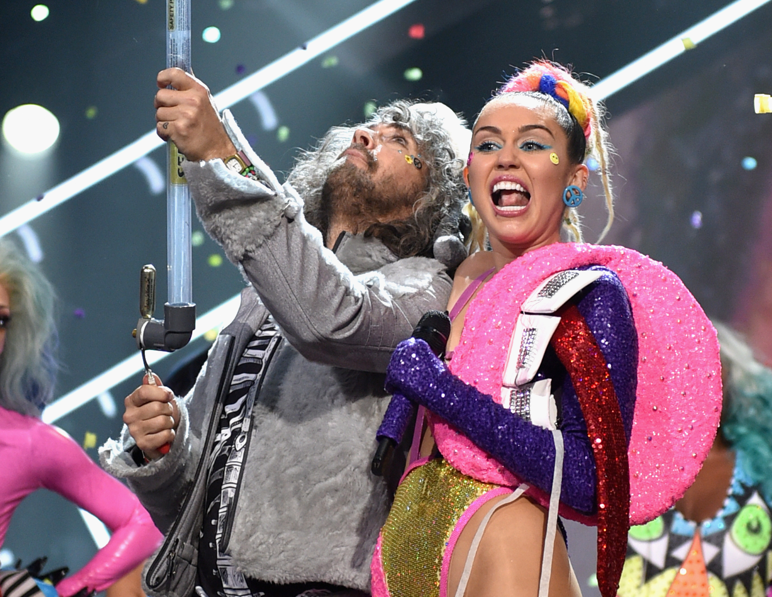 Musician Wayne Coyne of The Flaming Lips (L) and host Miley Cyrus, perform during the 2015 MTV Video Music Awards on August 30, 2015 in Los Angeles, California.