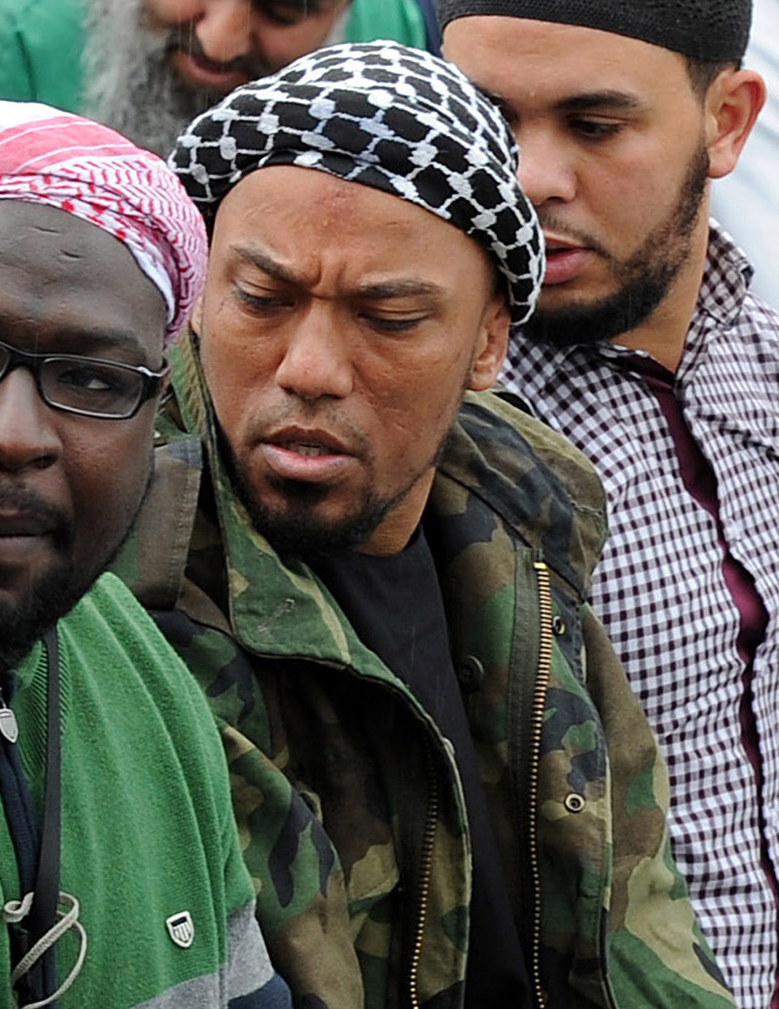 Picture taken on May 5, 2012, shows former German rapper Denis Cuspert, center, among Salafis in Bonn, Germany