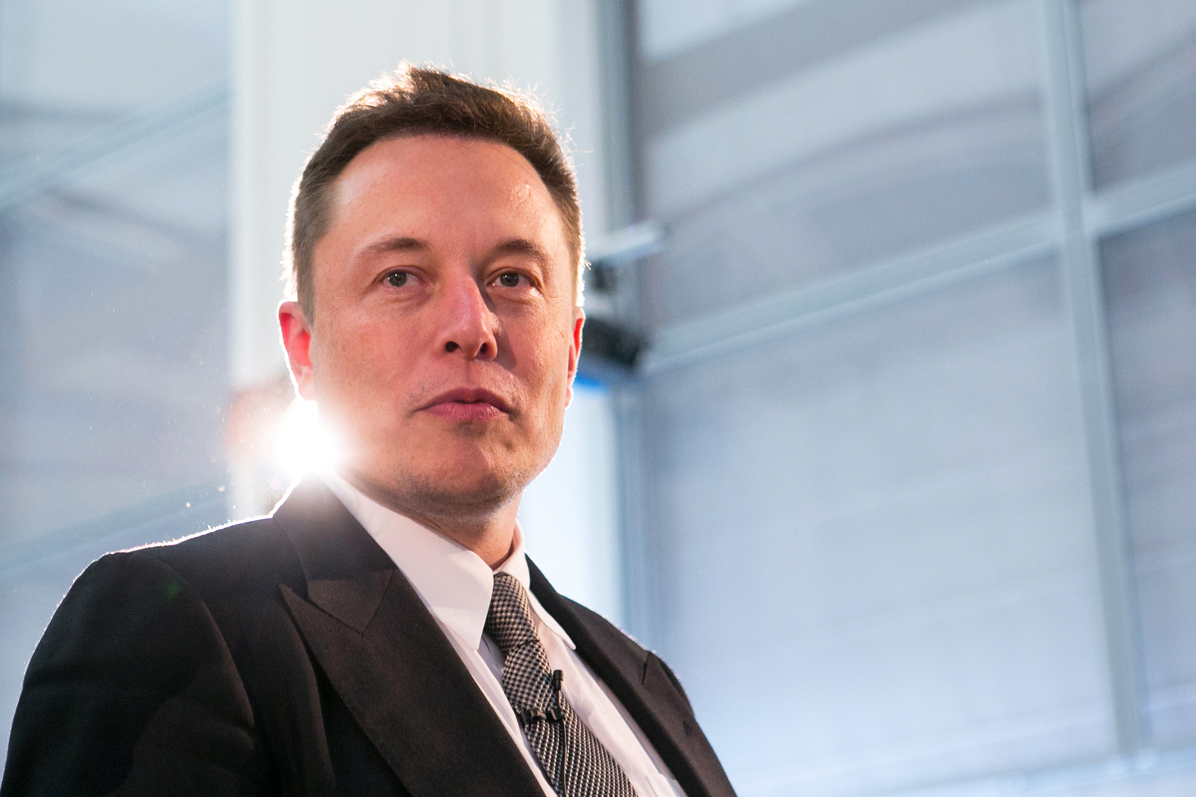 Elon Musk arrives for a news conference in Berlin, on Sept. 24, 2015.