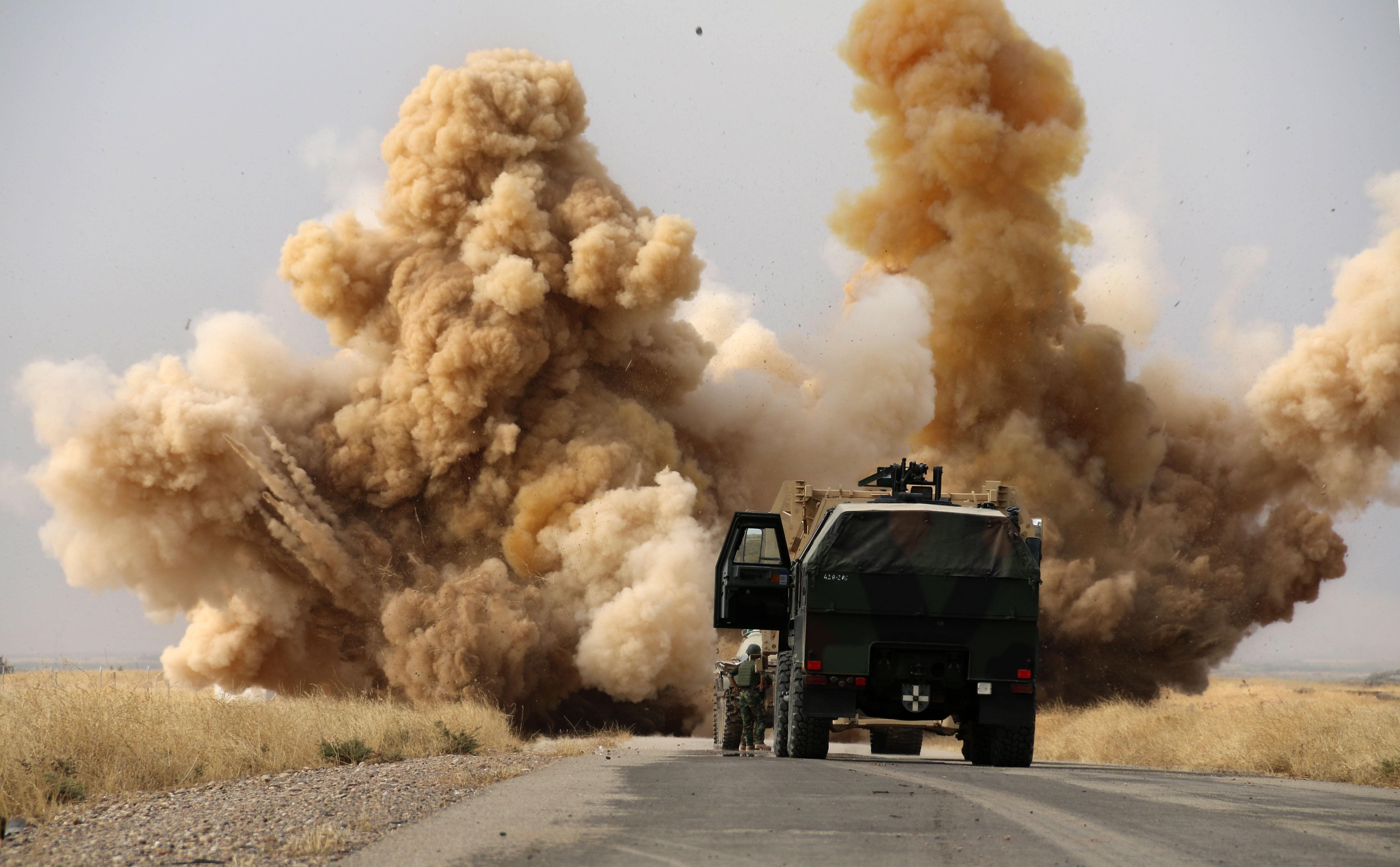 Kurdish peshmerga forces detonate improvised explosive devices placed by ISIS on a road outside the northern Iraq city of Kirkuk on Wednesday.