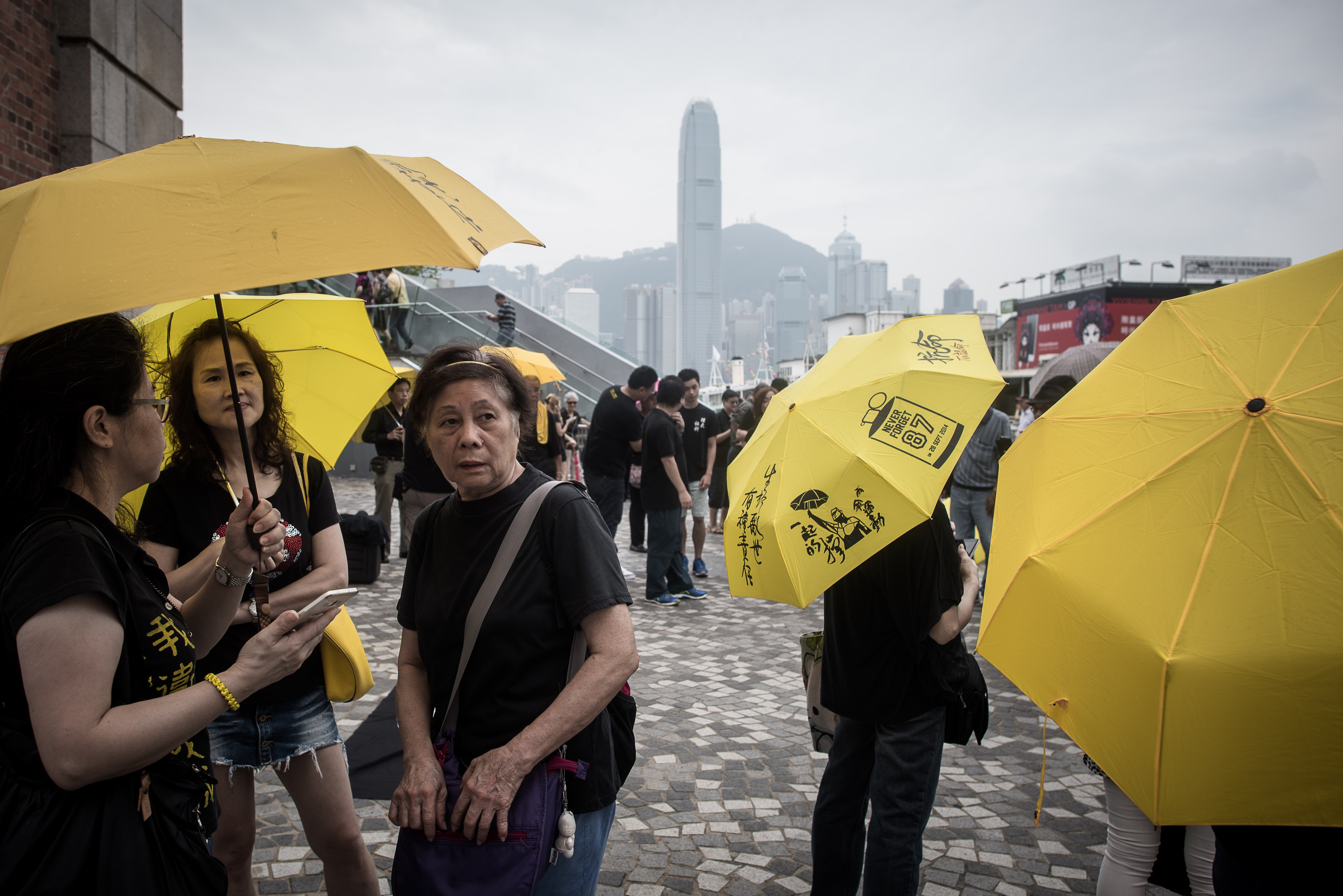 Pro-democracy demonstrators hold yellow umbrellas, a symbol of the pro-democracy movement in Hong Kong on Oct. 1, 2015, as they gather on China's National Day to denounce Beijing's influence over the territory