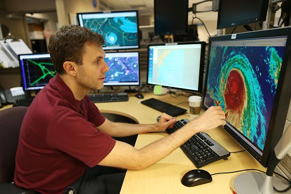 Eric Blake, Hurricane Specialist, uses a computer at the National Hurricane Center to track the path of Hurricane Joaquin.