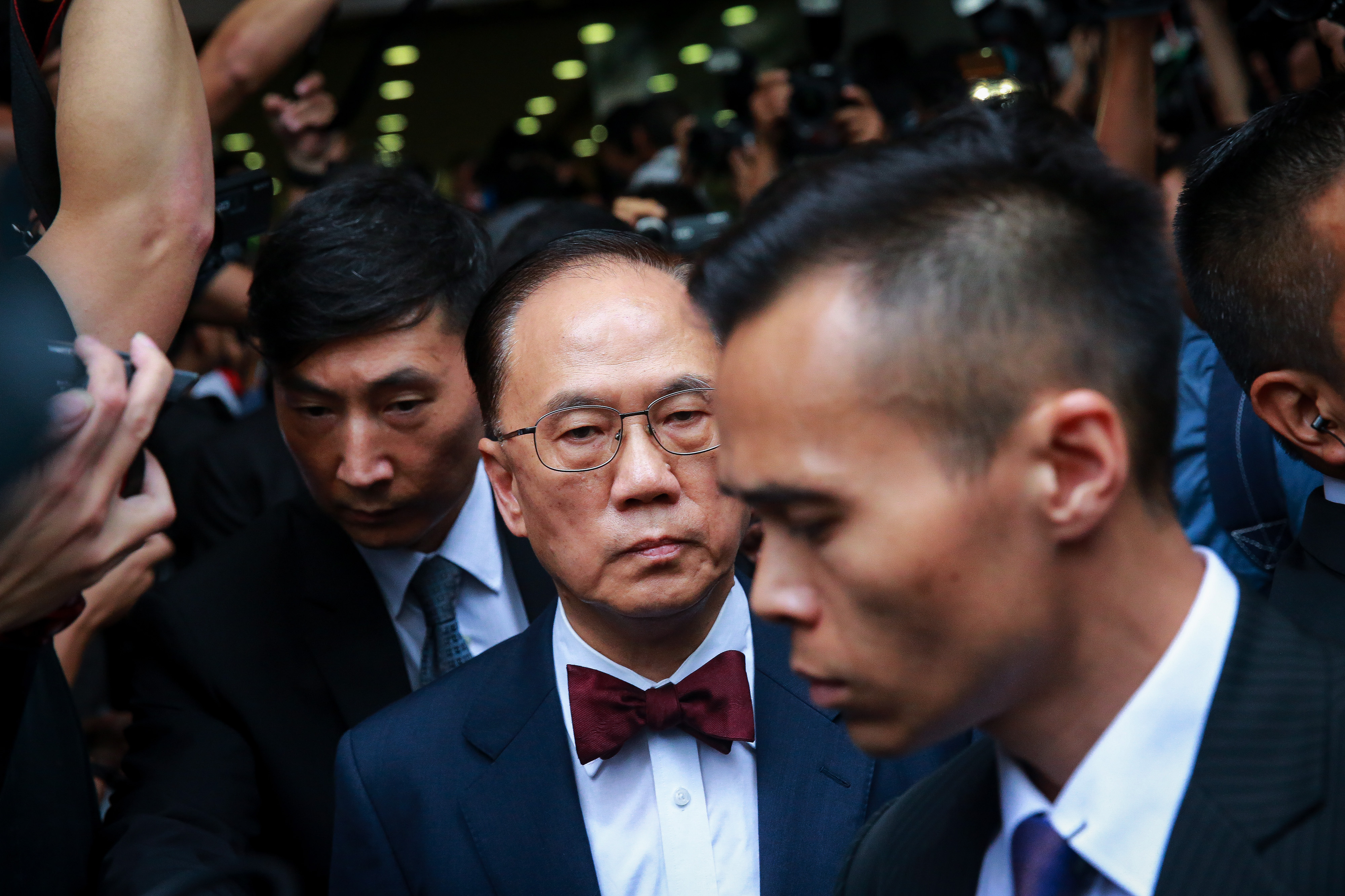 Donald Tsang, Hong Kong's former chief executive, center, leaves the Eastern Law Courts in Hong Kong on  Oct. 5, 2015