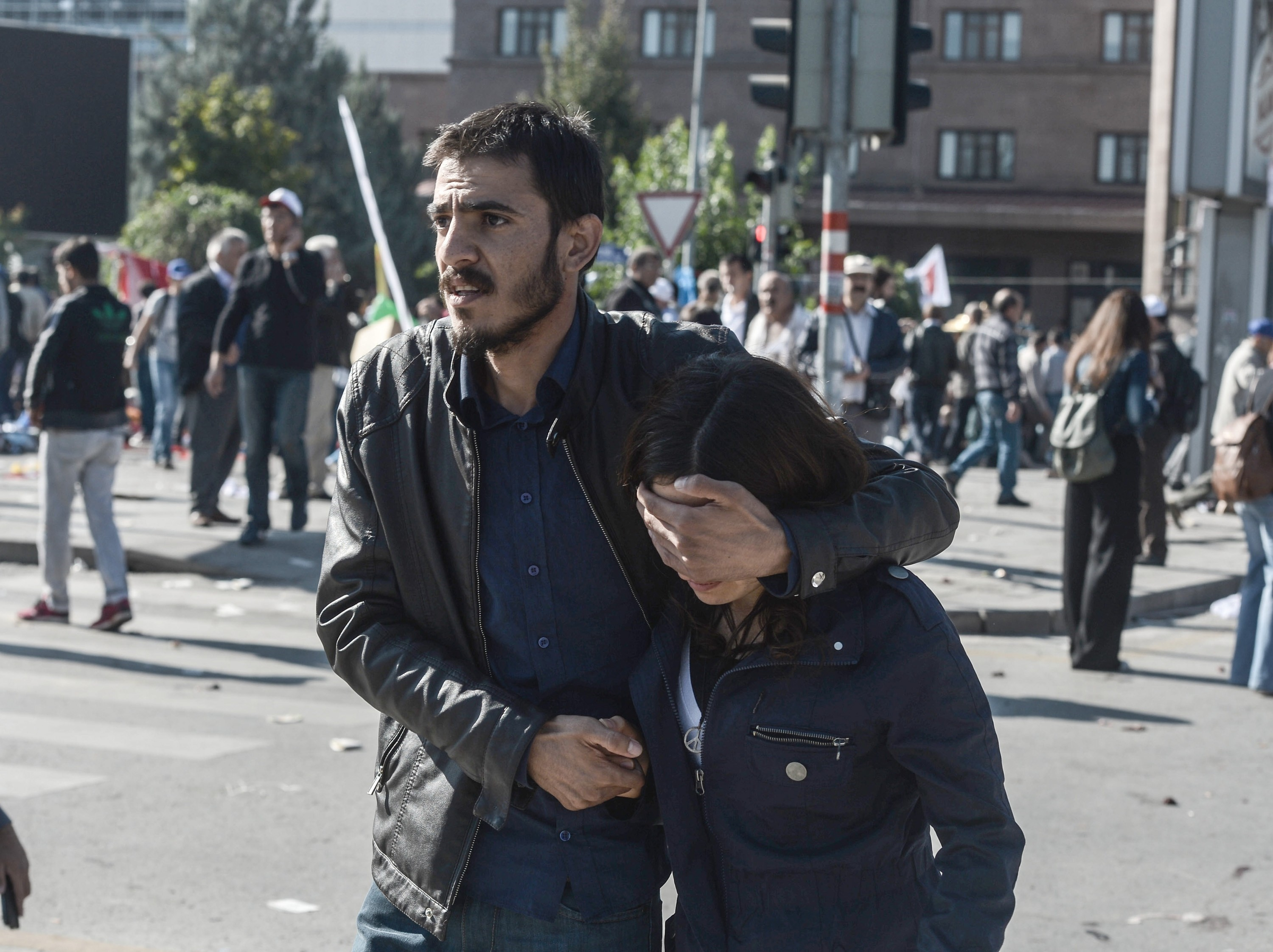 People are seen at the site of an explosion close to Ankara's main train station on Oct. 10, 2015 in Ankara, Turkey.