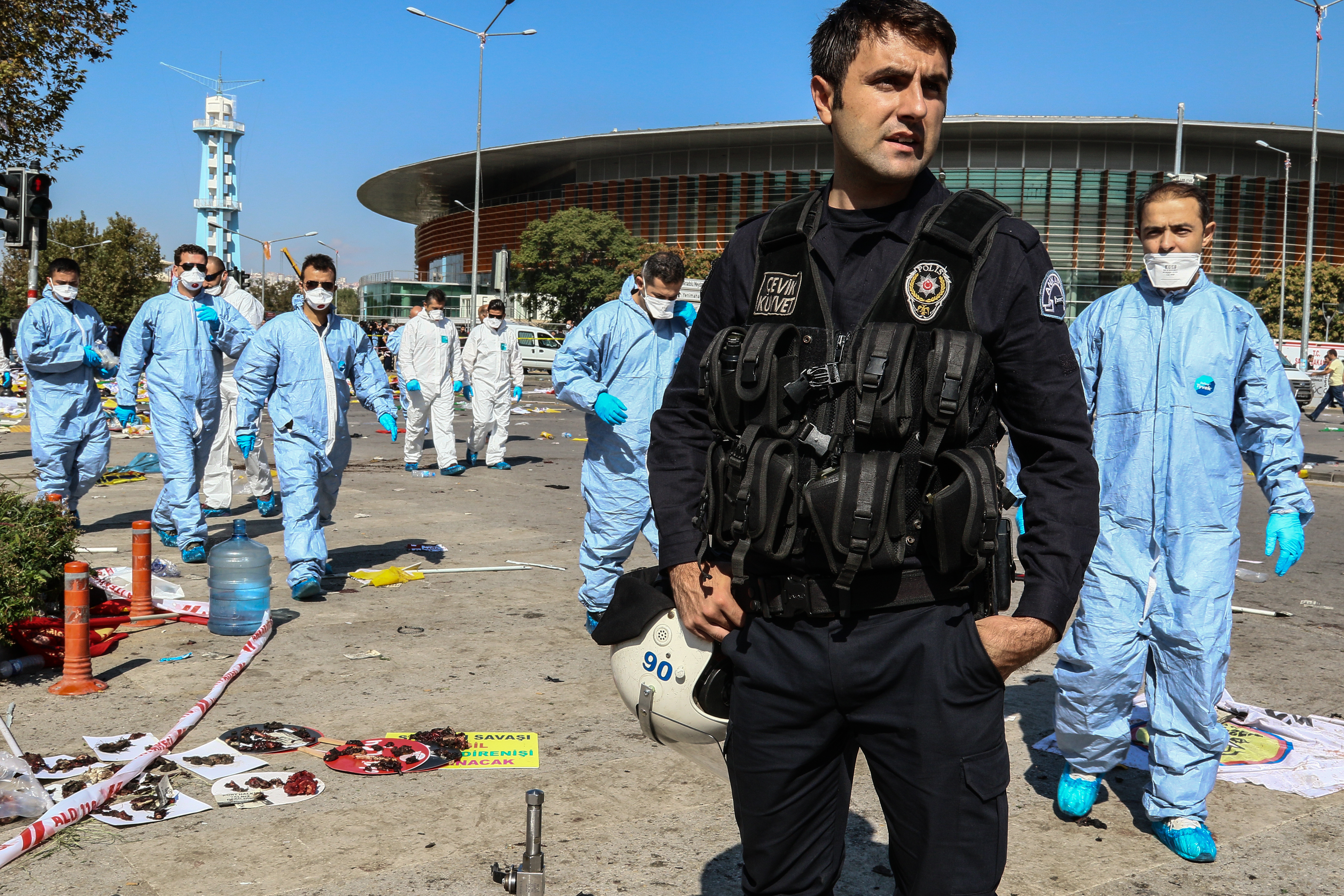Turkish security forces and forensic police inspect the blast site after an explosion during a peace march in Ankara, on Oct. 10, 2015 Turkey.