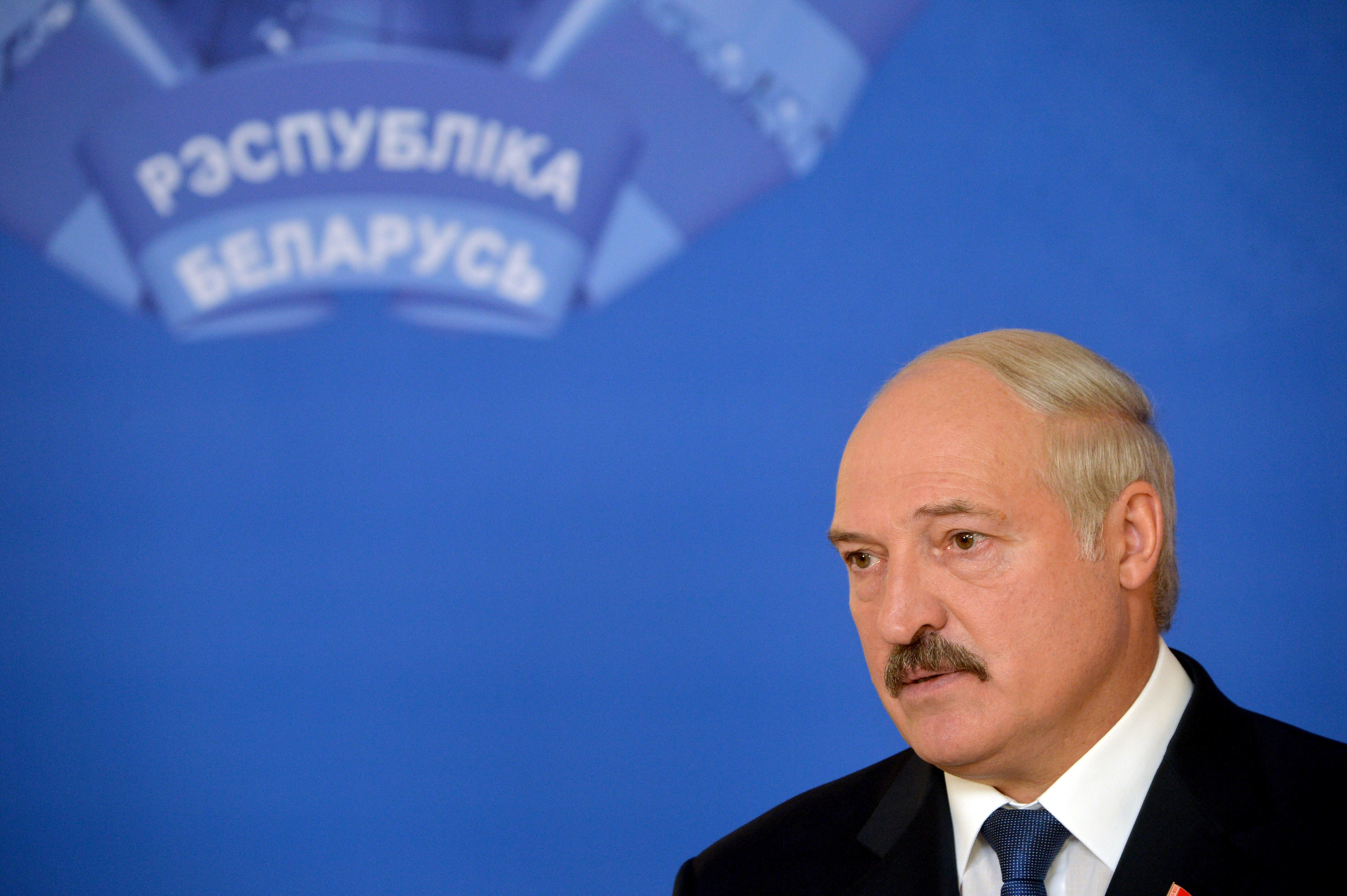Belarus' President Alexander Lukashenko speaks with journalists at a polling station in Minsk, Belarus, on Oct. 11, 2015