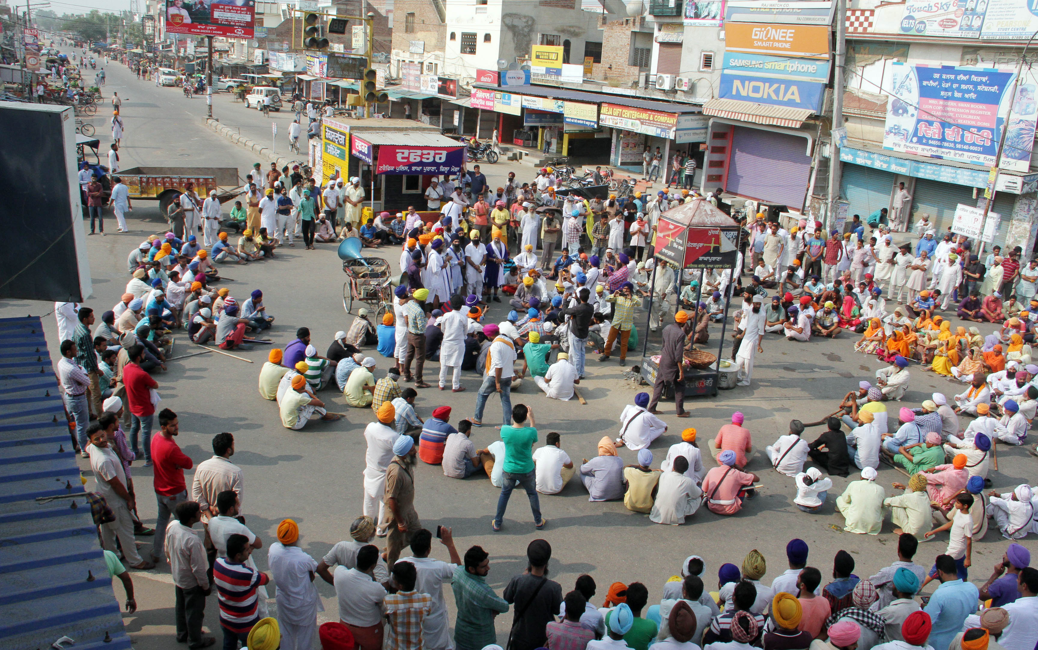 Sikh community staging a demonstration over the alleged desecration of a holy book at Baghapurana in Moga, India, on Oct. 14, 2015