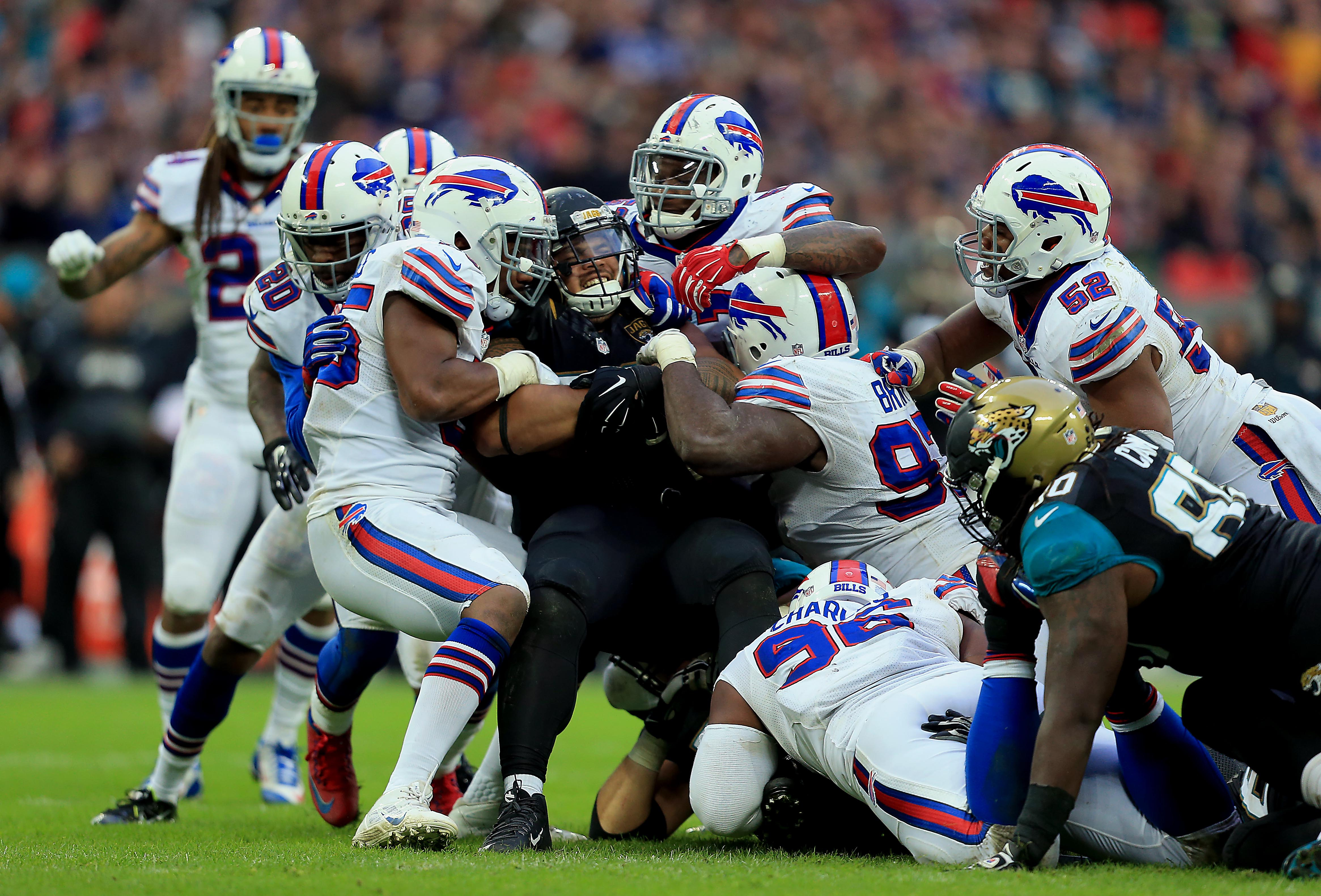 Jacksonville Jaguars' Tyson Alualu (#93) is tackled during an NFL football game against the Buffalo Bills on Oct. 25, 2015 at Wembley Stadium in London.