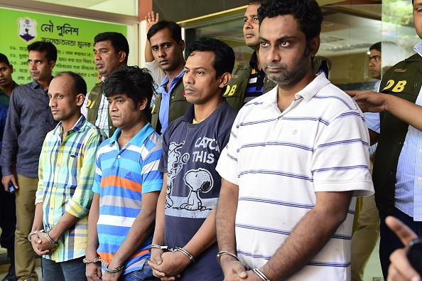 Bangladesh police escort, from right, Minhajul Abedin Russel, Russel Chowdhury, Shakhawat Hossain and Tamjid Ahmed Rubel after they were arrested on Oct. 26, 2015, over the murder of  Italian aid worker Cesare Tavella in Dhaka