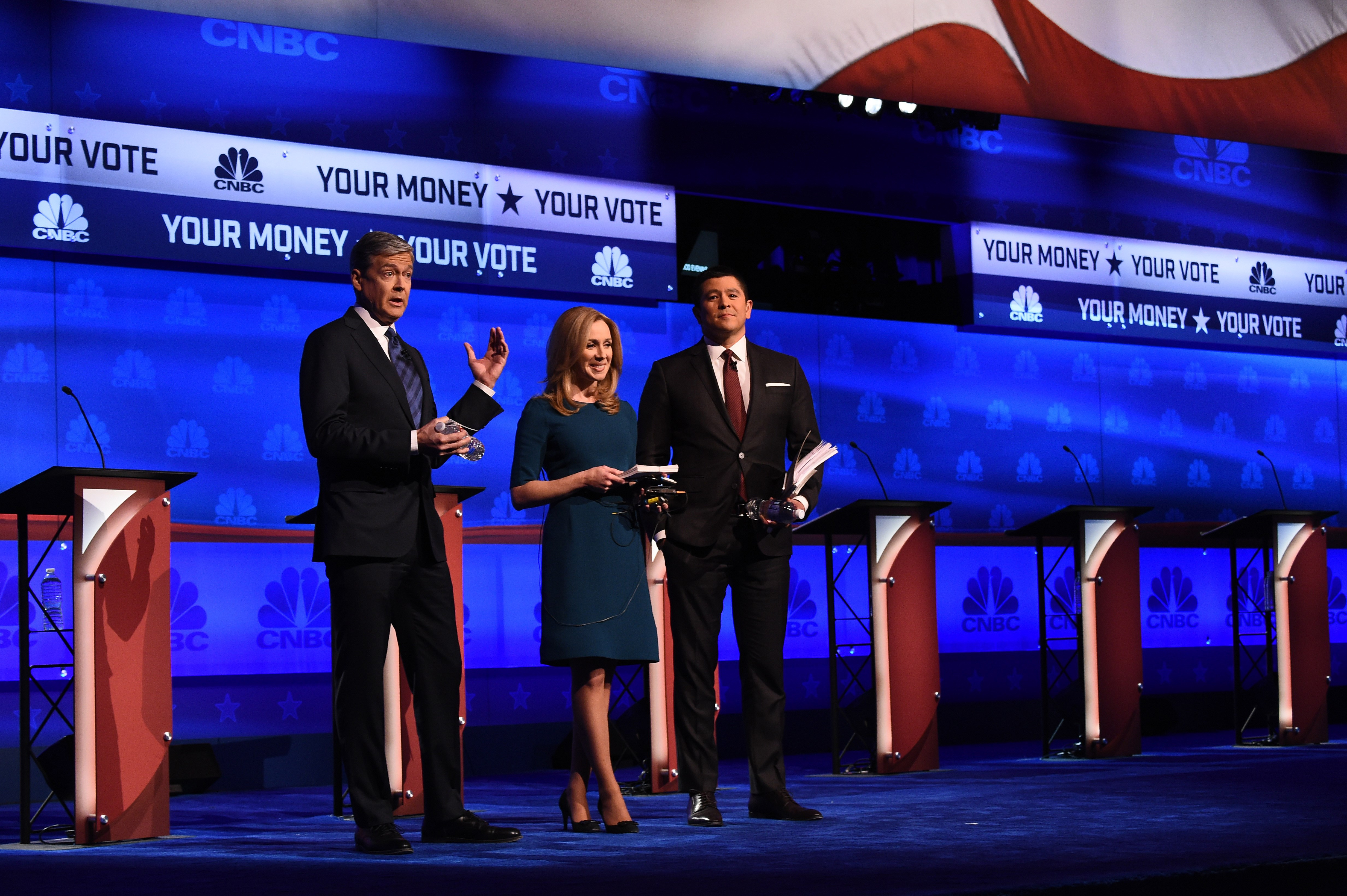 Debate moderators John Harwood (L), Becky Quick (C) and Carl Quintanilla take the stage at the third Republican Presidential Debate hosted by CNBC, October 28, 2015 at the Coors Event Center at the University of Colorado in Boulder, Colorado.  AFP PHOTO / ROBYN BECK        (Photo credit should read ROBYN BECK/AFP/Getty Images)