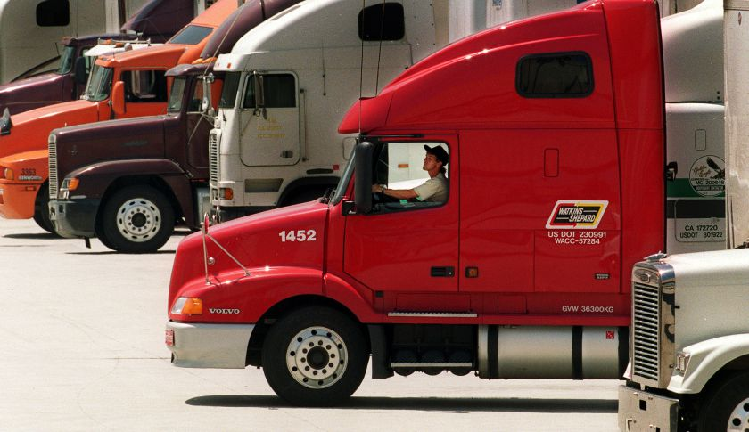 A trucker backs up his rig at a supermarket in Los Angeles.