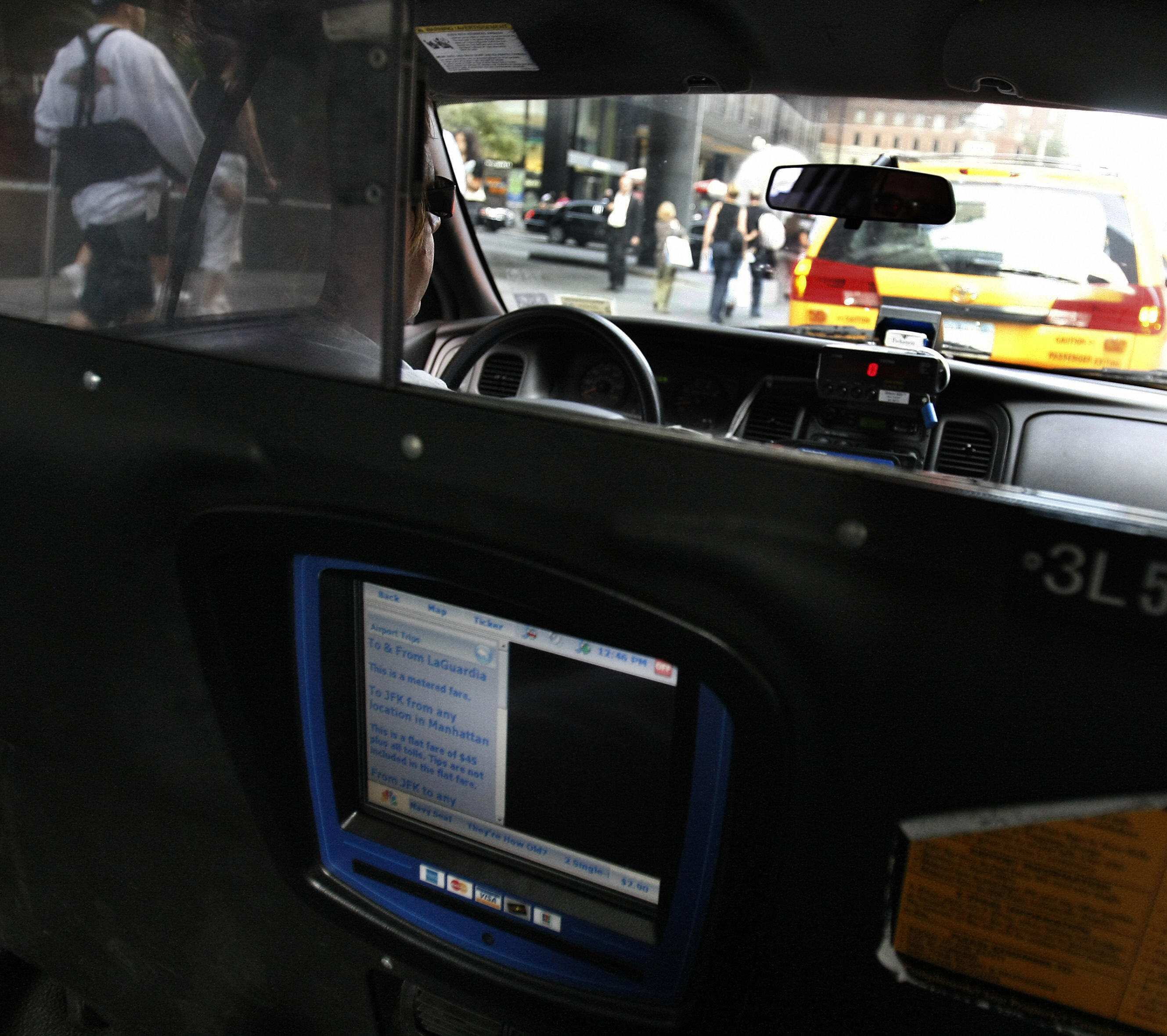 A New York City cab driver waits in line on 6th Avenue 22 October 2007.