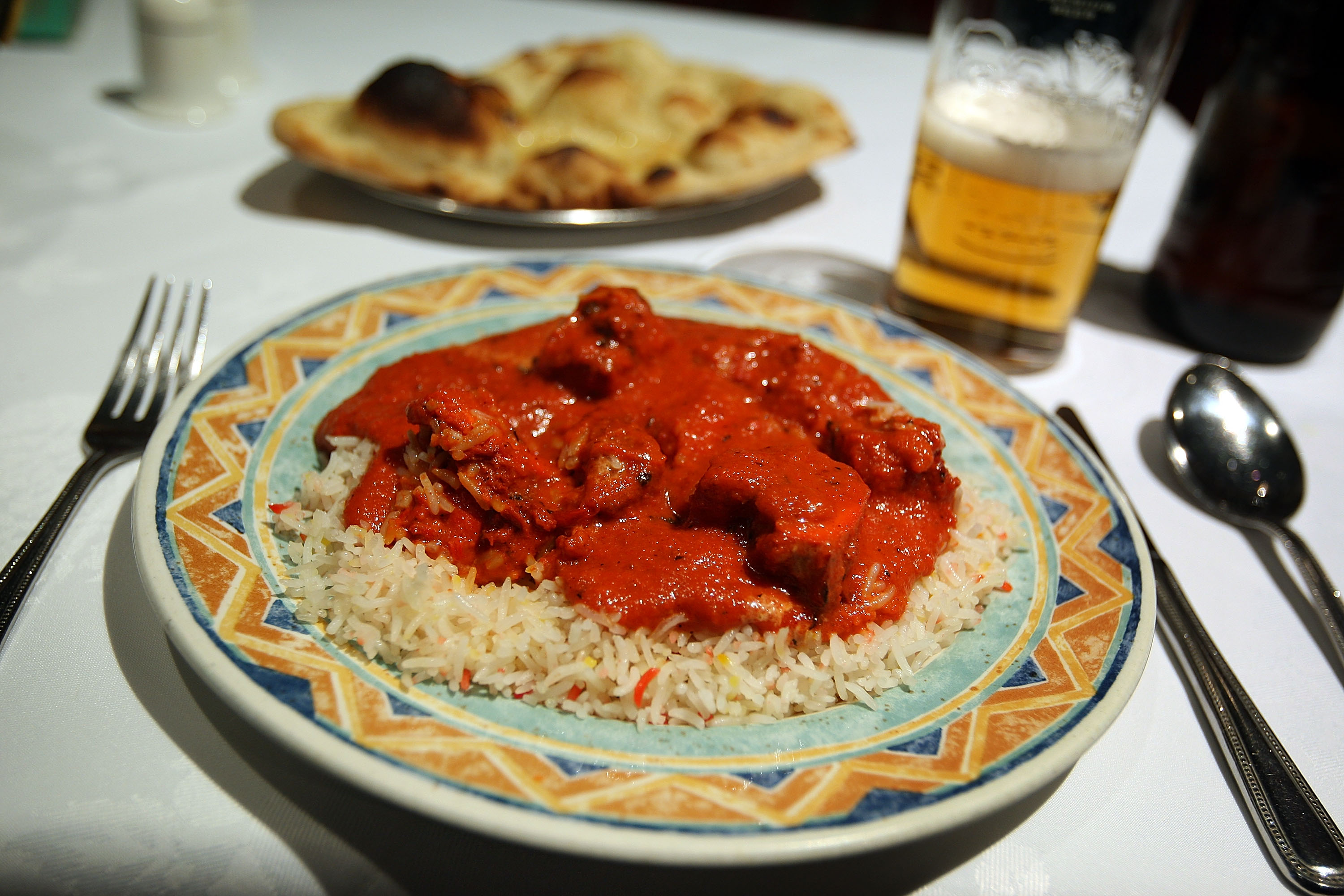 A plate of chicken tikka masala in a London curry restaurant