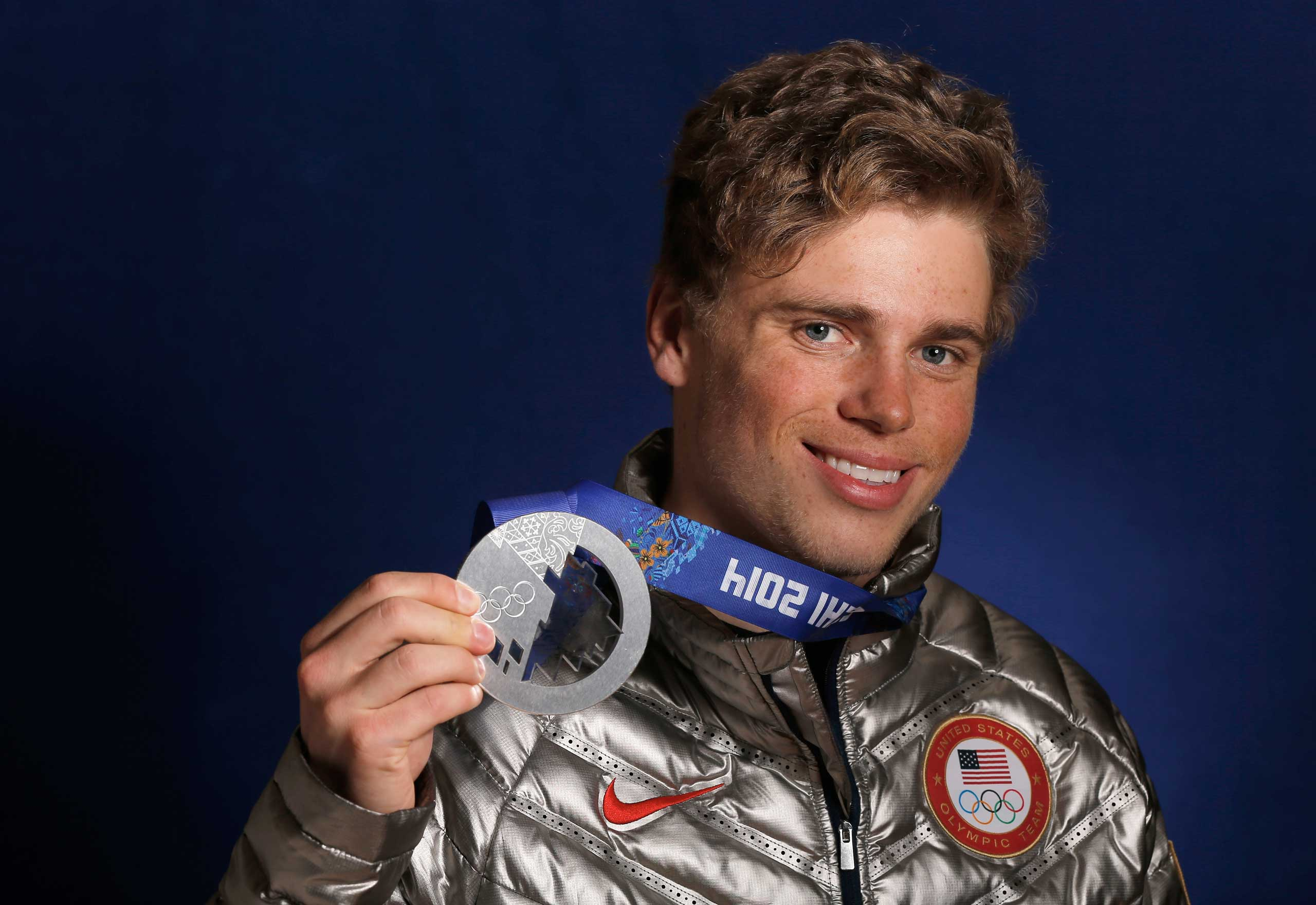 Gus Kenworthy of the USA Skiing team poses with his silver medal in the Olympic Park during the Sochi 2014 Winter Olympics in Sochi, Russia, on Feb. 14, 2014.