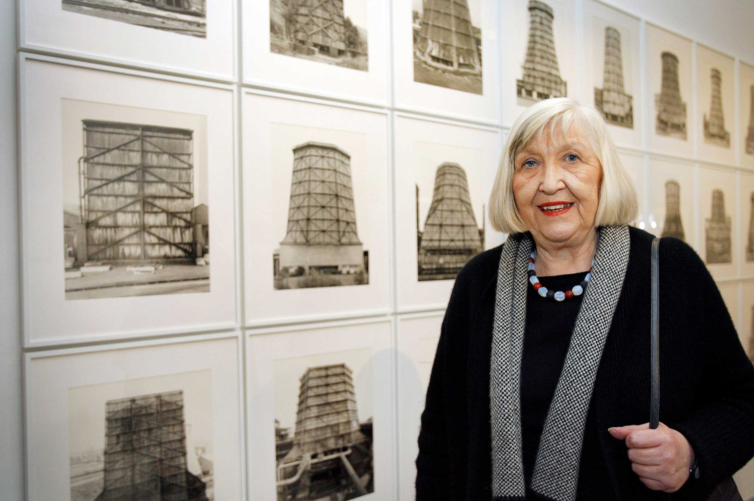 German photographer Hilla Becher posing next to her photo series  Cooling Towers  at the Musee d'Art Moderne de la Ville in Paris, France, on Oct. 2, 2008.