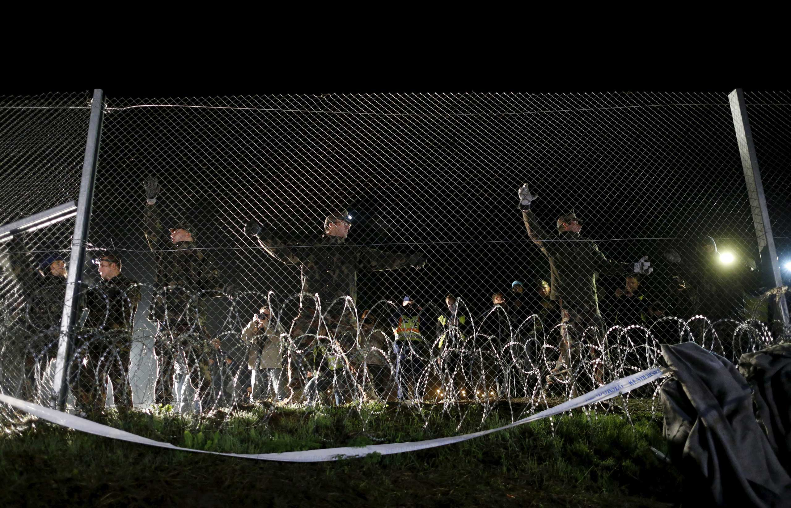 Hungarian soldiers close a border with Croatia near the village of Botovo, Croatia, on Oct. 17, 2015.