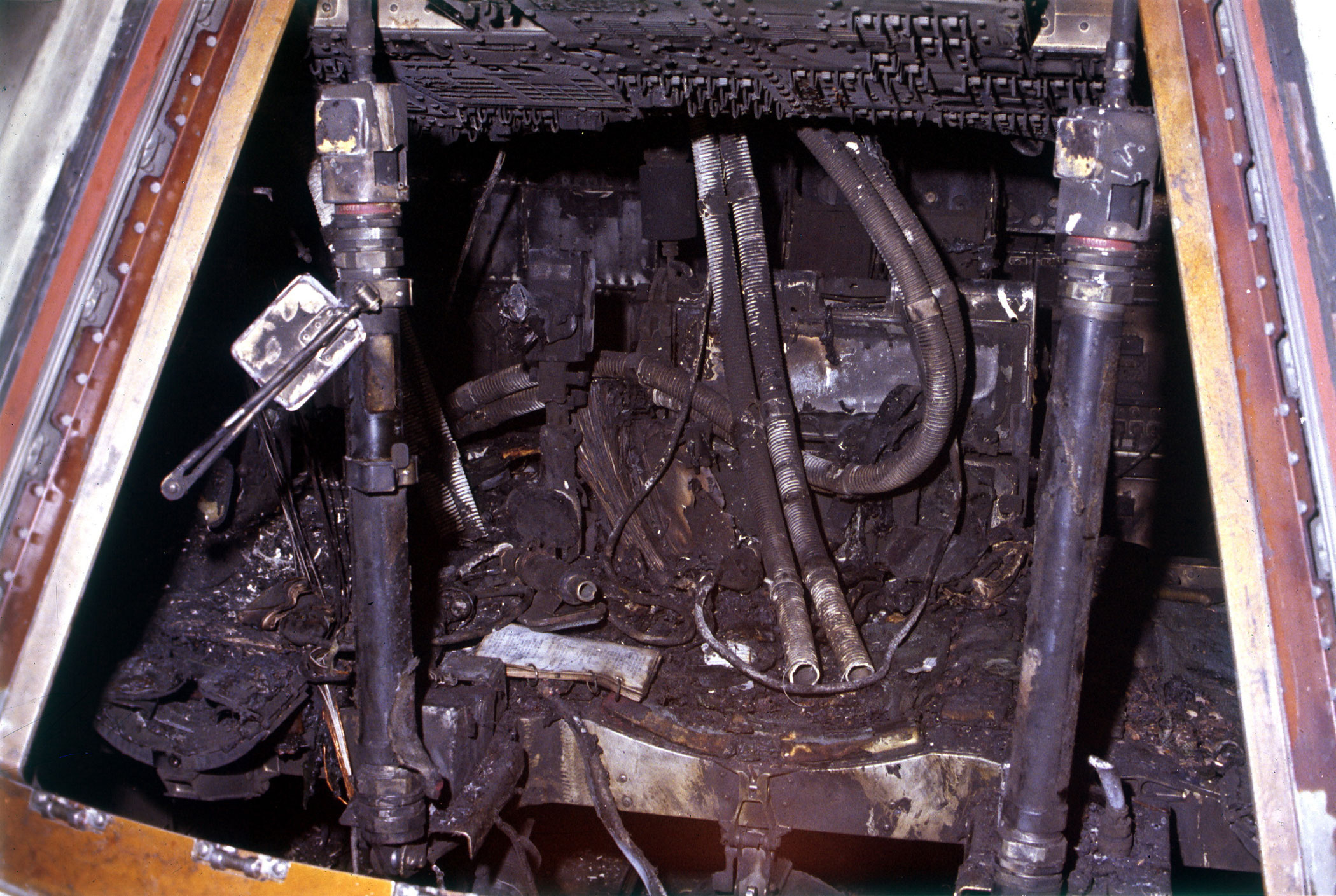 <b>Incinerated remains of Apollo 1, 1967</b>; The image was captured following the tragic disaster that struck the Apollo 1 mission. A fire inside the capsule caused the death of all three astronauts, 3 weeks before its planned launch.
