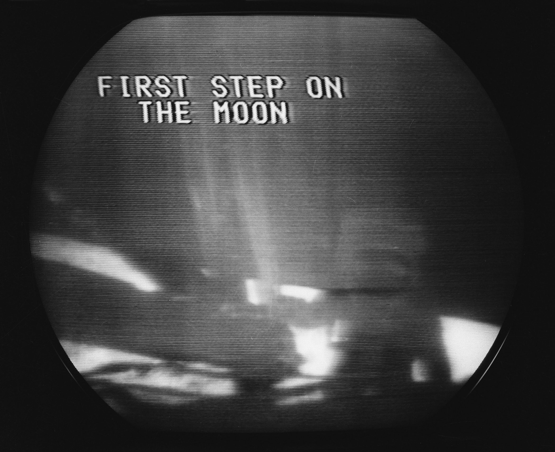 <b>First Steps on the Moon on Television, 1969</b>; Kinescope images of astronaut Commander Neil Armstrong taking the first steps on the moon during the Apollo 11 Space Mission's moon landing for the first time in history.