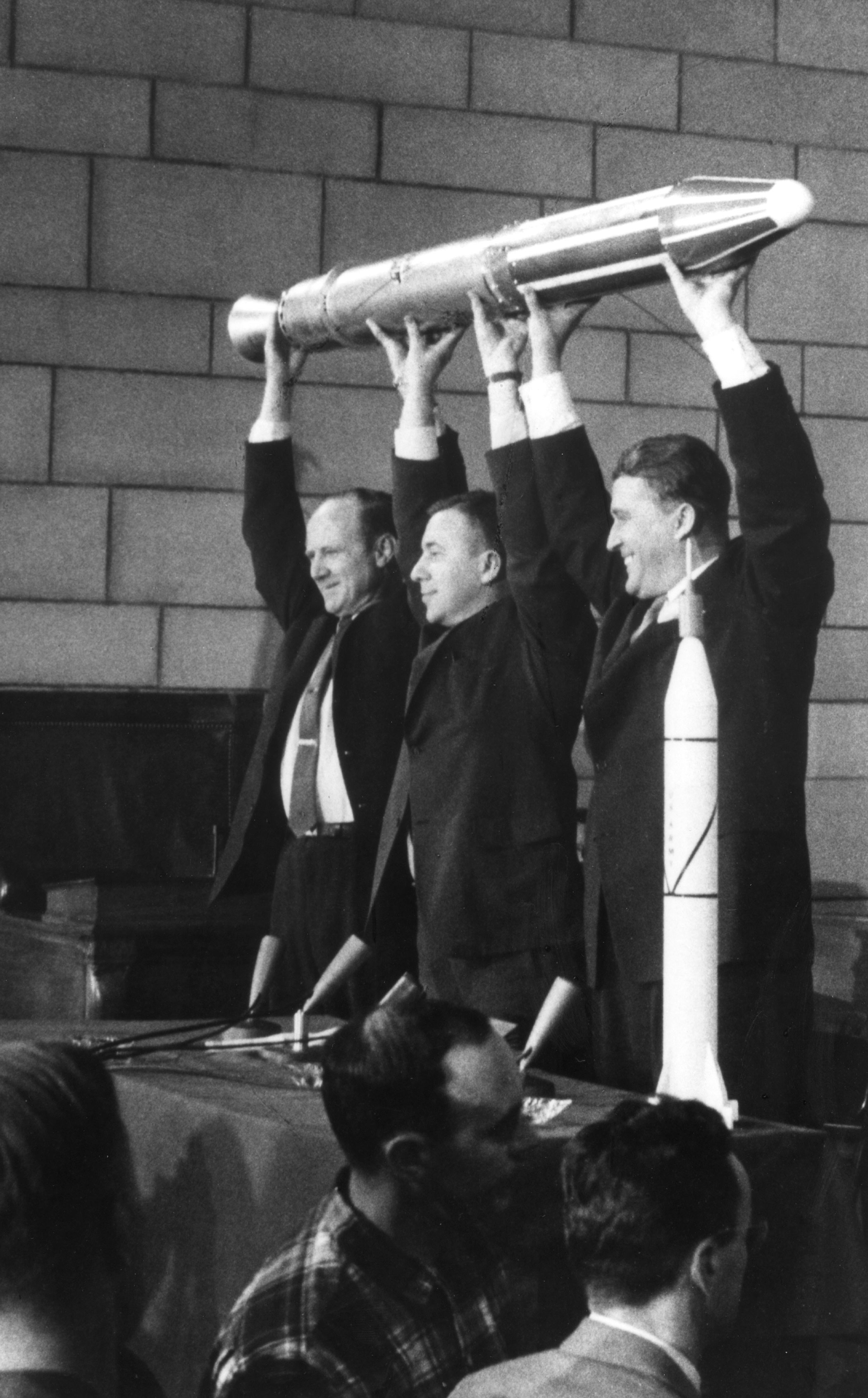 <b>Scientists with First U.S. Satellite Model, 1958</b>; William H, Pickering, James Van Allen, And Wernher Von Braun triumphantly raising a full-size model of the first U.S, Satellite, Explorer 1, at a press conference following the craft's launch on Jan. 31, 1958