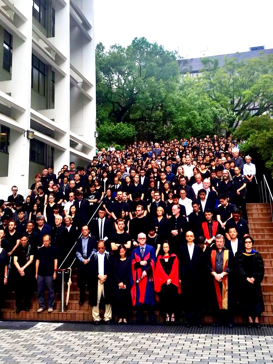 Faculty and students of the University of Hong Kong gather on the steps of the university's Sun Yat-sen Place after their silent protest march on Oct. 6, 2015