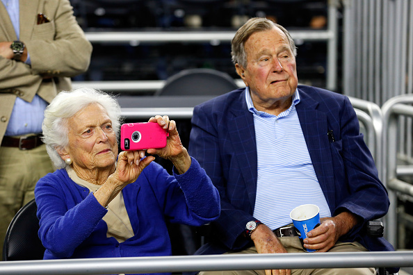 Former First Lady Barbara Bush and former President George H.W. Bush look on prior to the South Regional Final of the 2015 NCAA Men's Basketball Tournament between the Duke Blue Devils and the Gonzaga Bulldogs at NRG Stadium on March 29, 2015 in Houston, Texas.