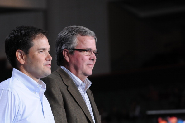 Senator Marco Rubio and Governor Jeb Bush attend Mitt Romney victory campaign Rally at Bank United Center on October 31, 2012 in Miami, Florida.