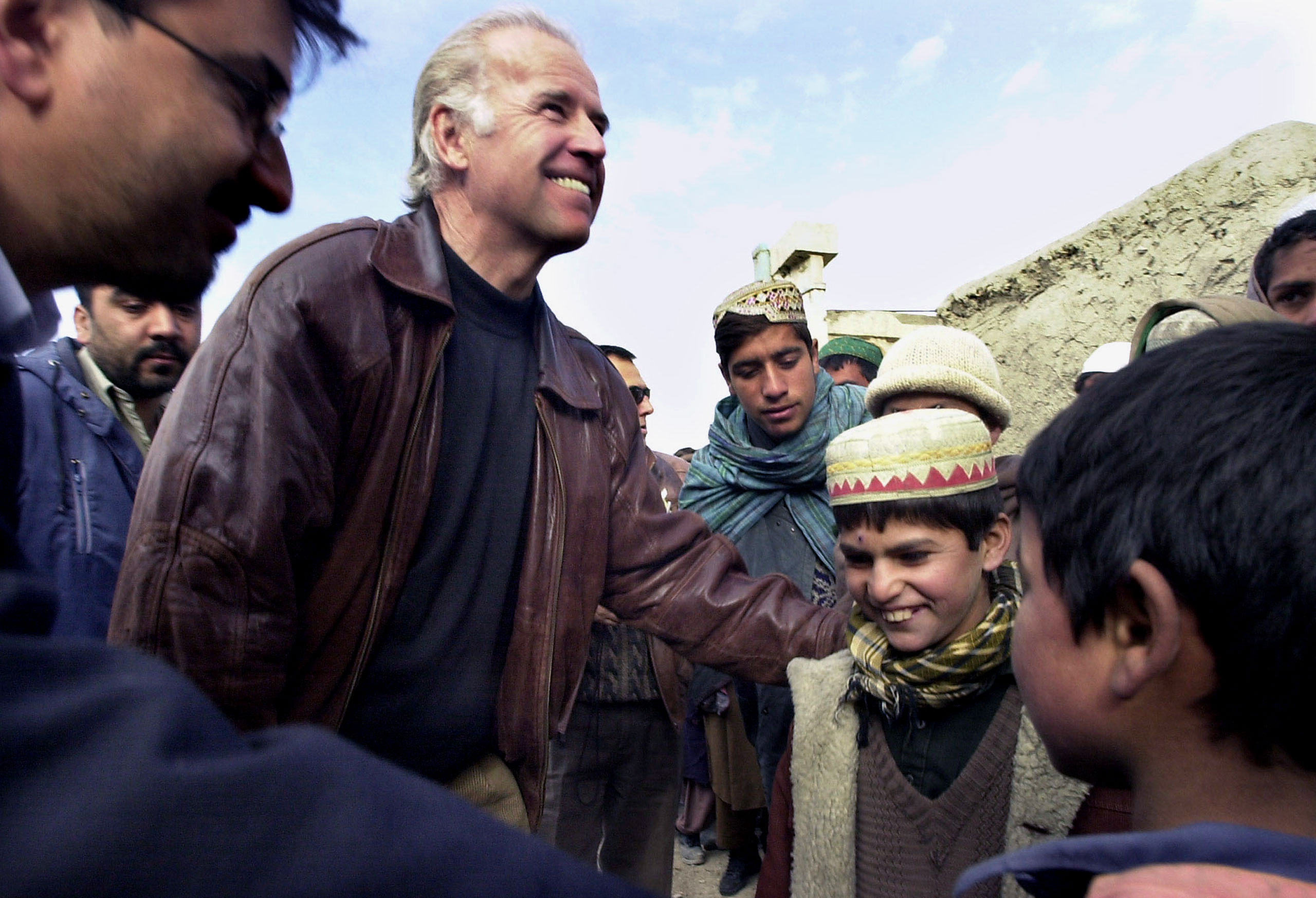 Joe Biden visits the old Soviet Embassy compound in Kabul on Jan. 11, 2002.