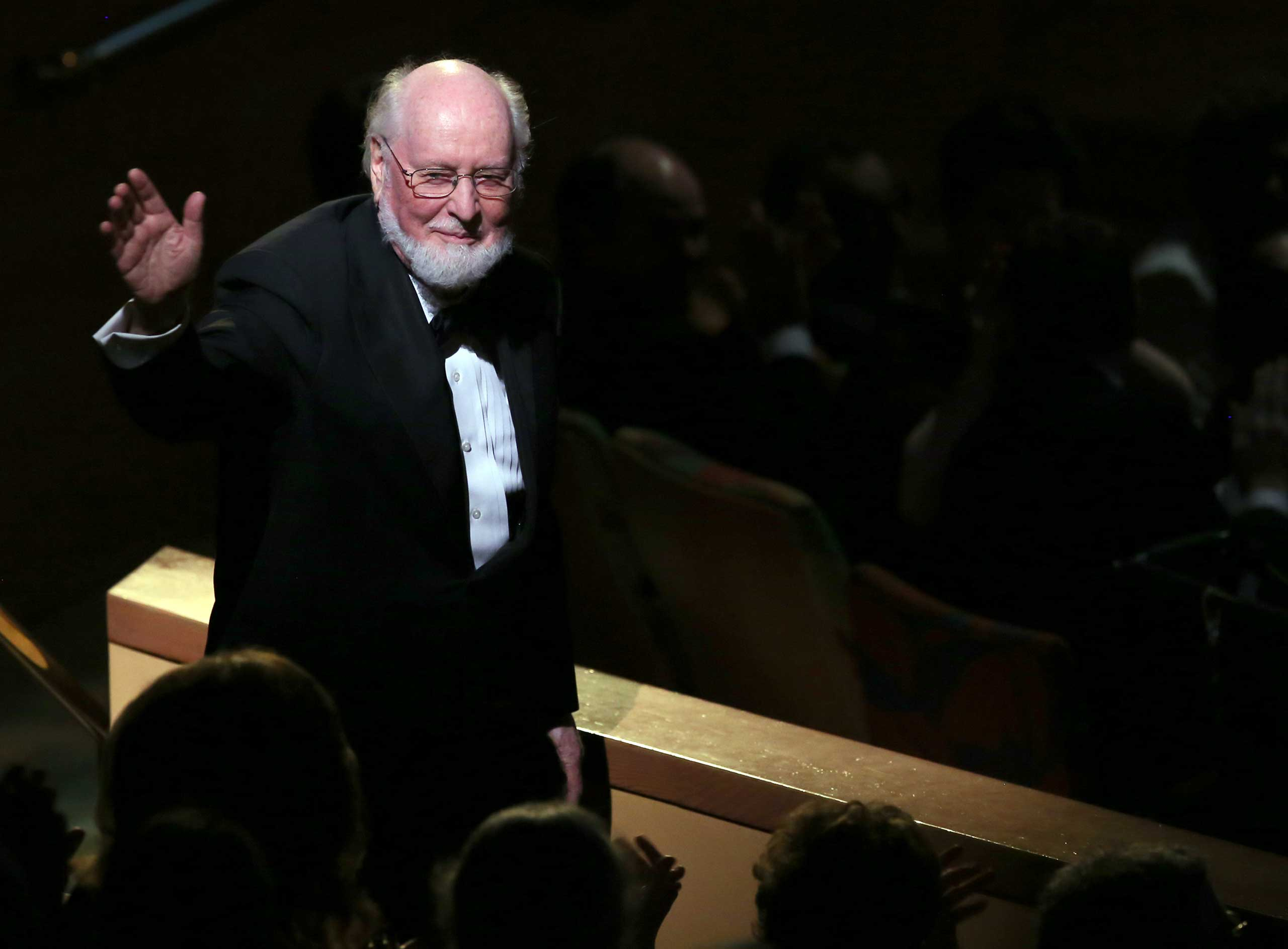 Composer John Williams waves to the audience at Los Angeles Philharmonic's Walt Disney Concert Hall Opening Night Gala  in Los Angeles, on Sept. 30, 2014.