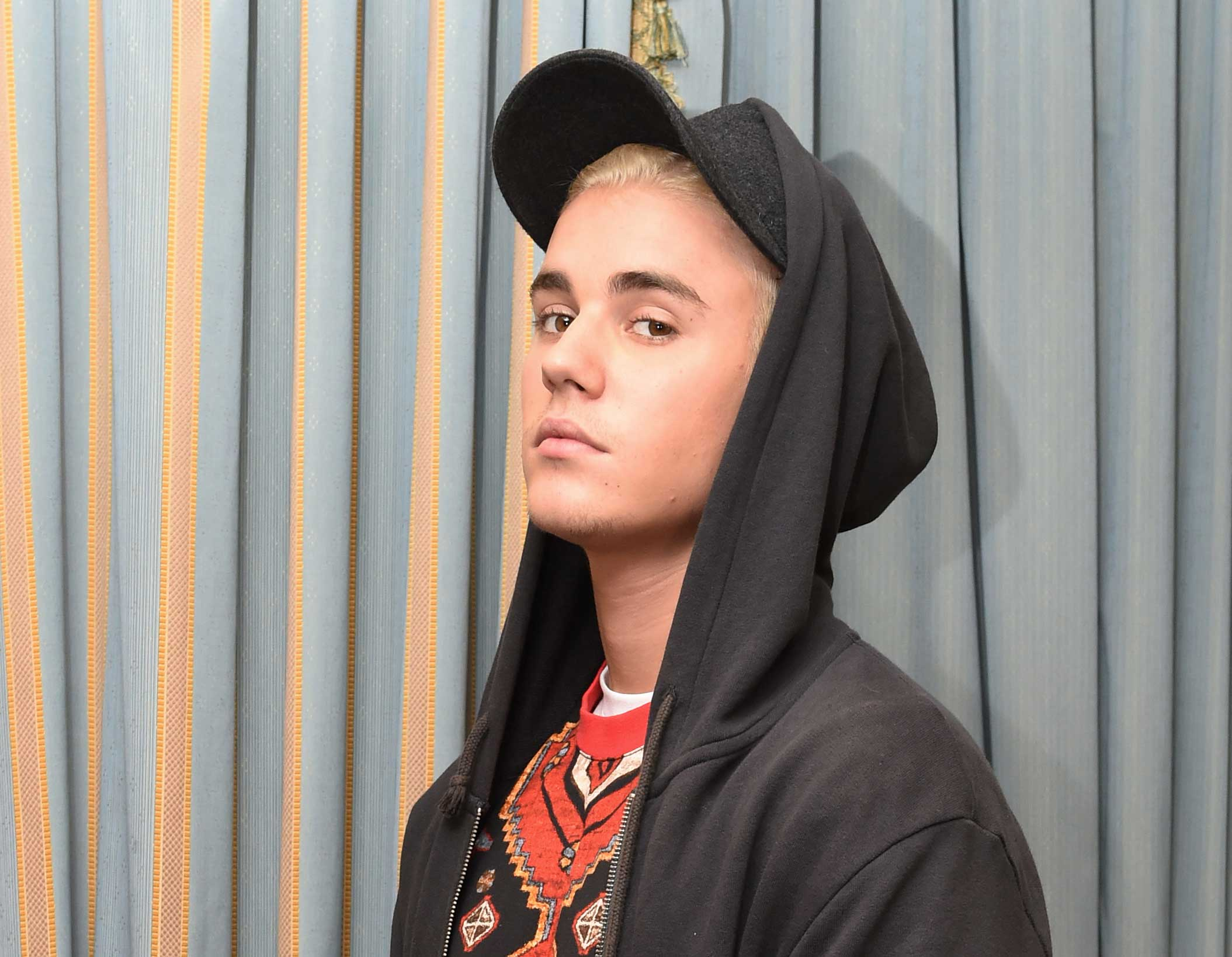 Canadian singer Justin Bieber poses during a press event at the Ritz Carlton Hotel in Berlin, Sept. 15, 2015.