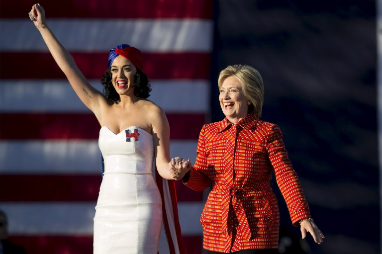 Democratic presidential candidate Hillary Clinton arrives with singer Katy Perry during a campaign rally in Des Moines, Iowa on Oct. 24, 2015.