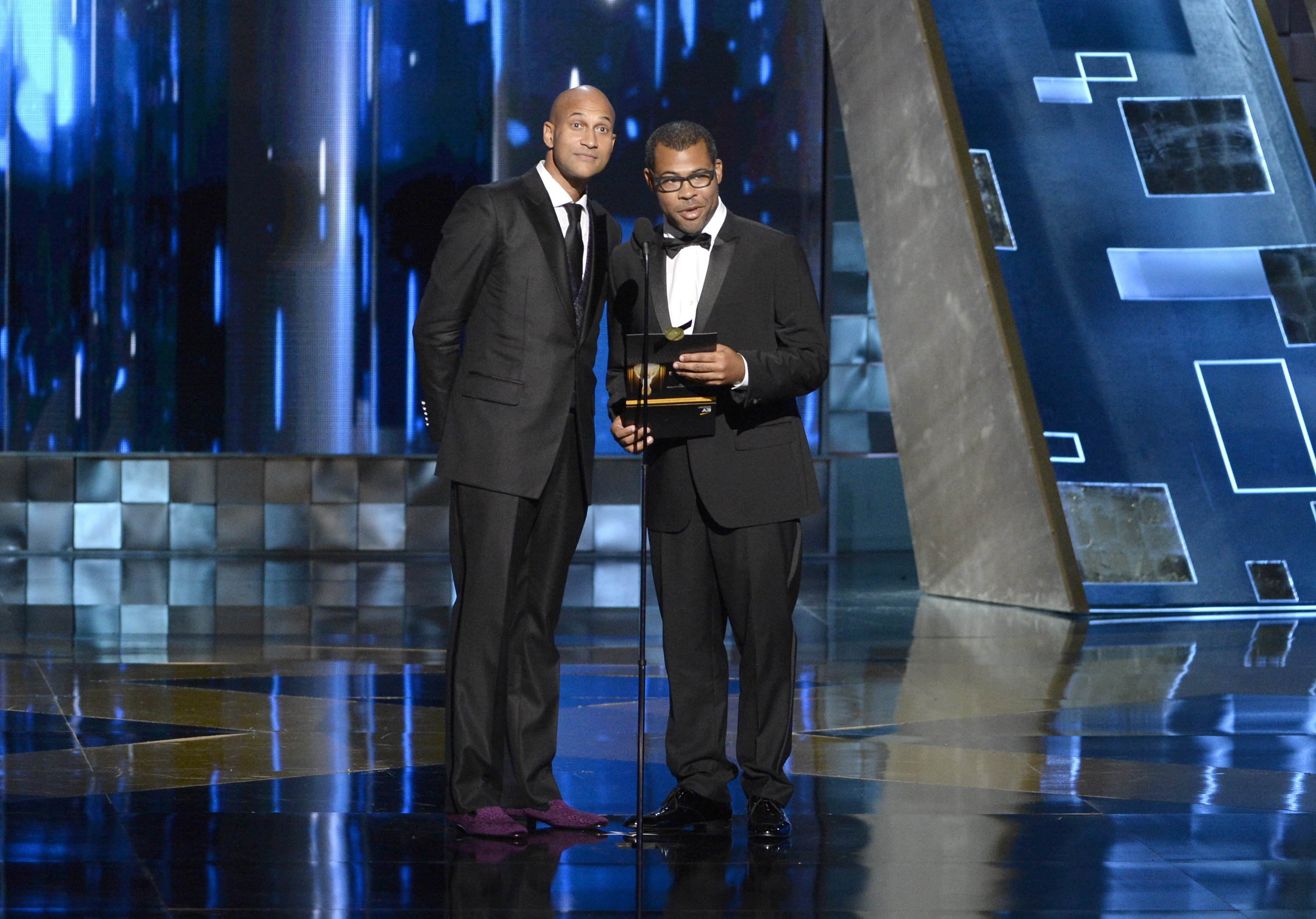 Keegan-Michael Key, left, and Jordan Peele present the award for outstanding reality - competition program at the 67th Primetime Emmy Awards on Sept. 20, 2015, at the Microsoft Theater in Los Angeles.
