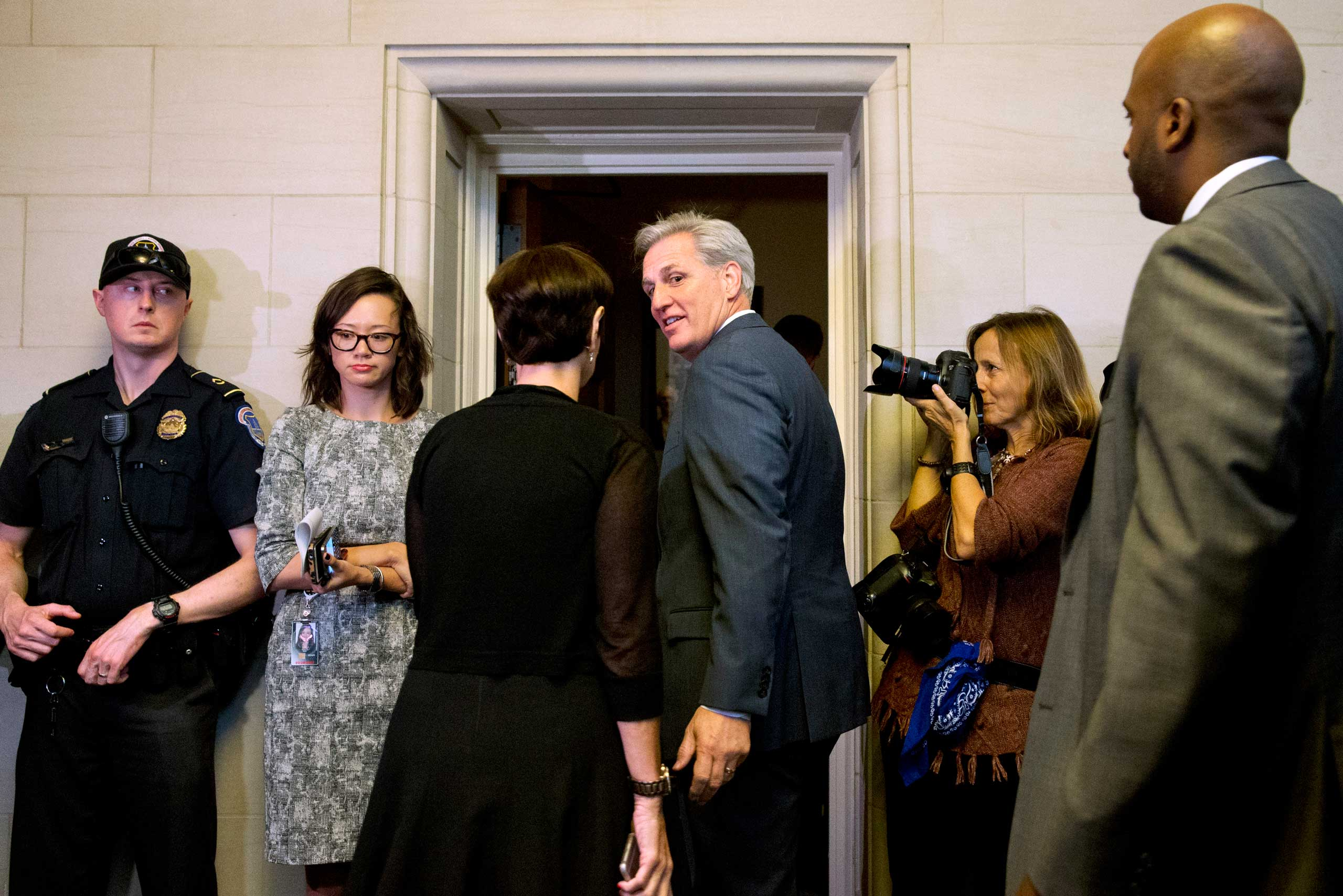 House Majority Leader Kevin McCarthy of Calif., center, turns to his wife Judy McCarthy as they enter a House Republican caucus vote on its nominee to replace House Speaker John Boehner, in Washington D.D., Oct. 8, 2015.