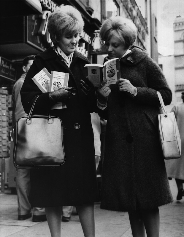 November 1960:  Two women outside a book shop in London, with paperback copies of 'Lady Chatterley's Lover' by D H Lawrence, after a jury at the Old Bailey decided that it was not obscene.