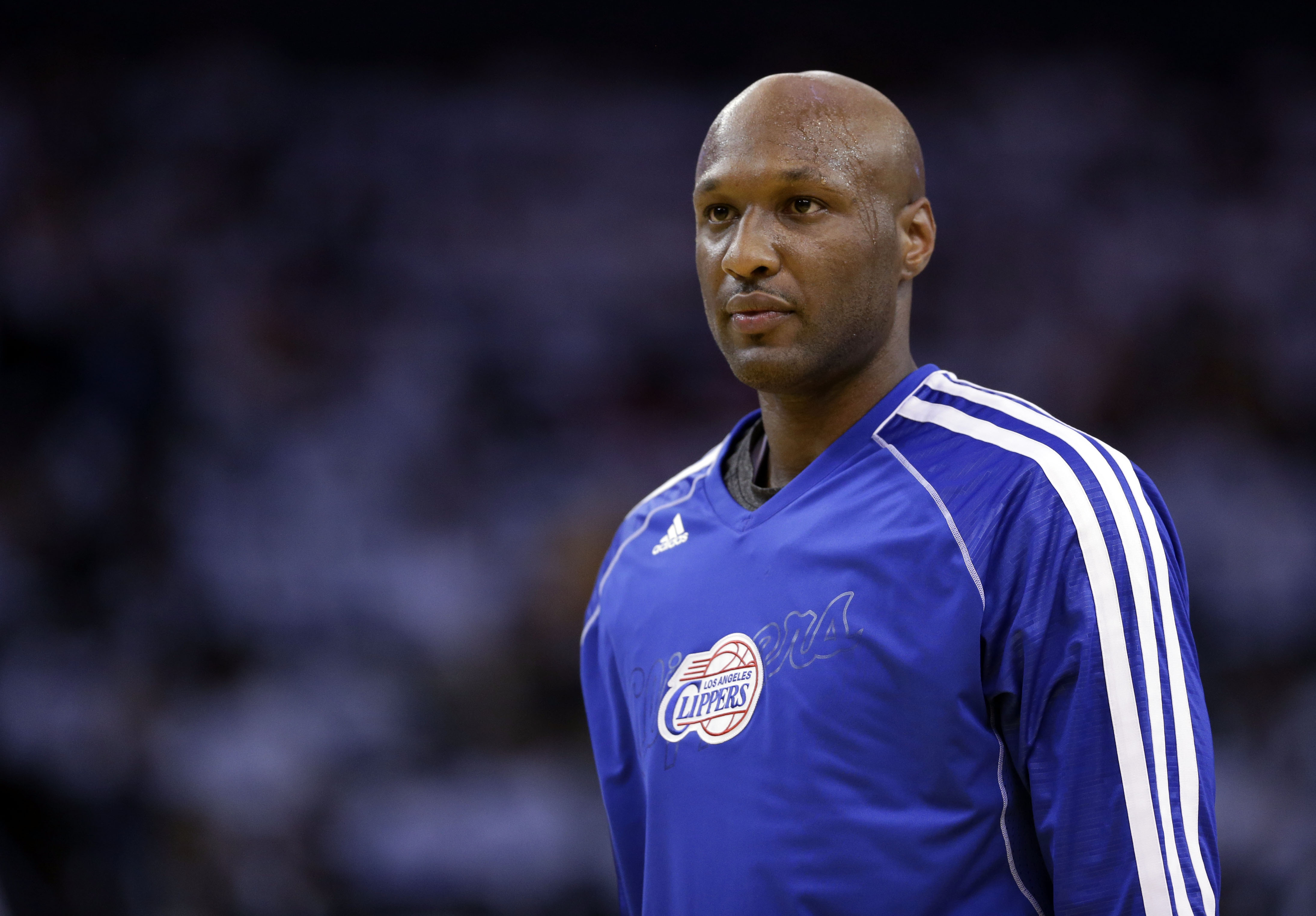 This  file photo shows Los Angeles Clippers' Lamar Odom (7) in action against the Golden State Warriors during an NBA basketball game in Oakland, Calif. on Jan. 2, 2013