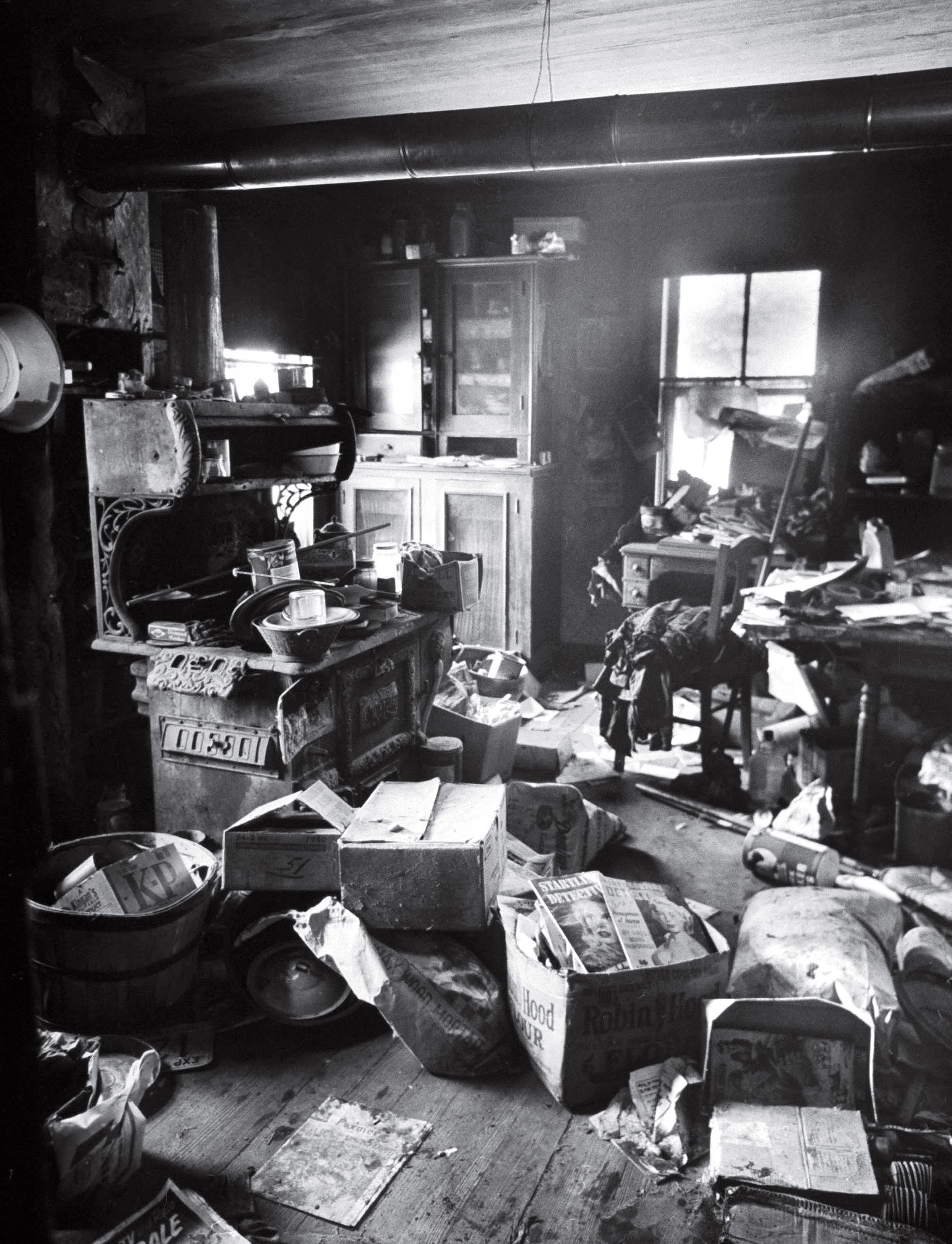 Filthy, cluttered kitchen of alleged mass murderer Ed Gein, where parts of his victim's bodies were found.