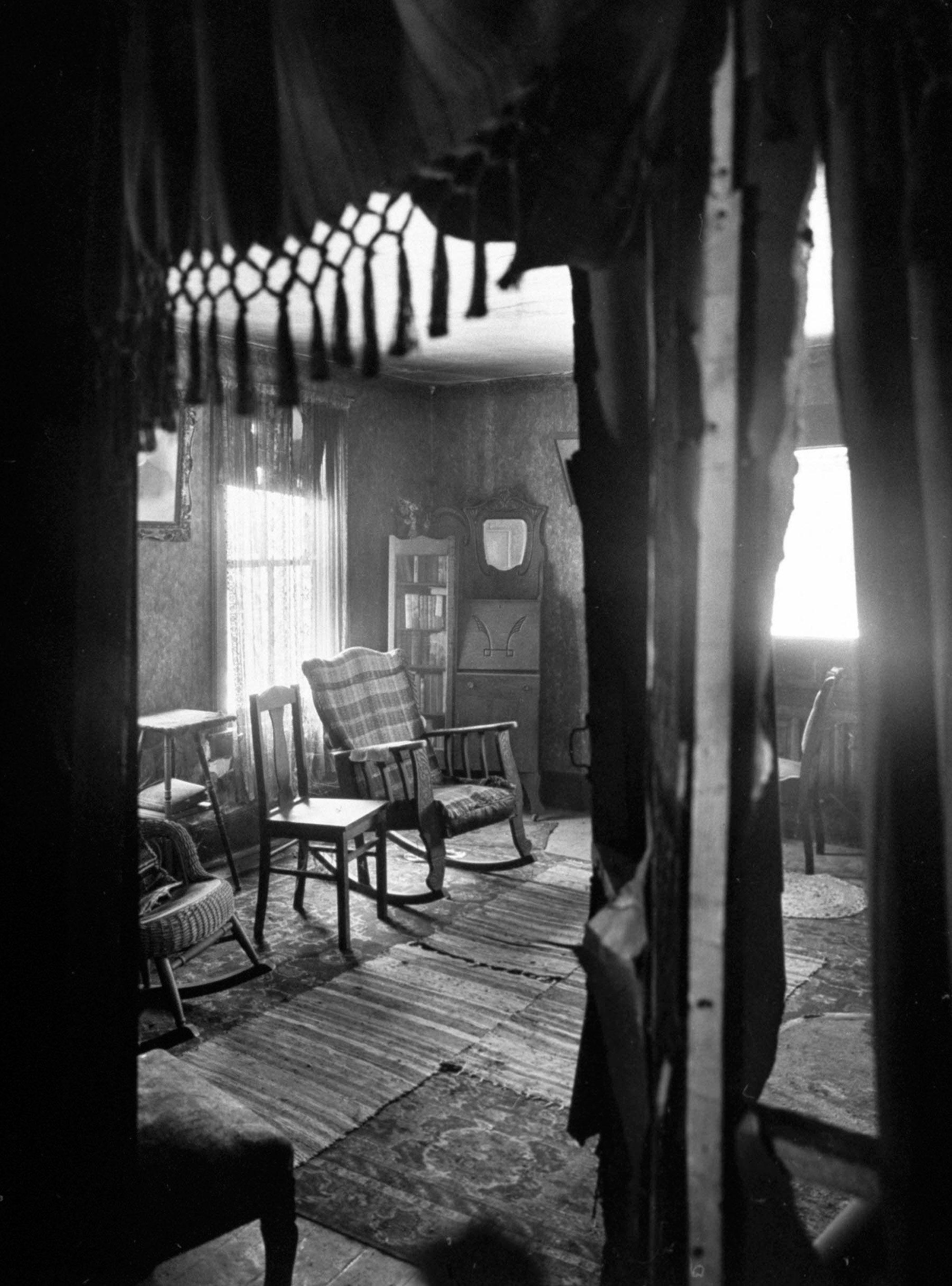 Neat, uncluttered room in alleged mass murderer Ed Gein's house which his mother had occupied; room was never used after her death and is in stark contrast to filthy, cluttered rooms in rest of the house, where parts of his victim's bodies were found.