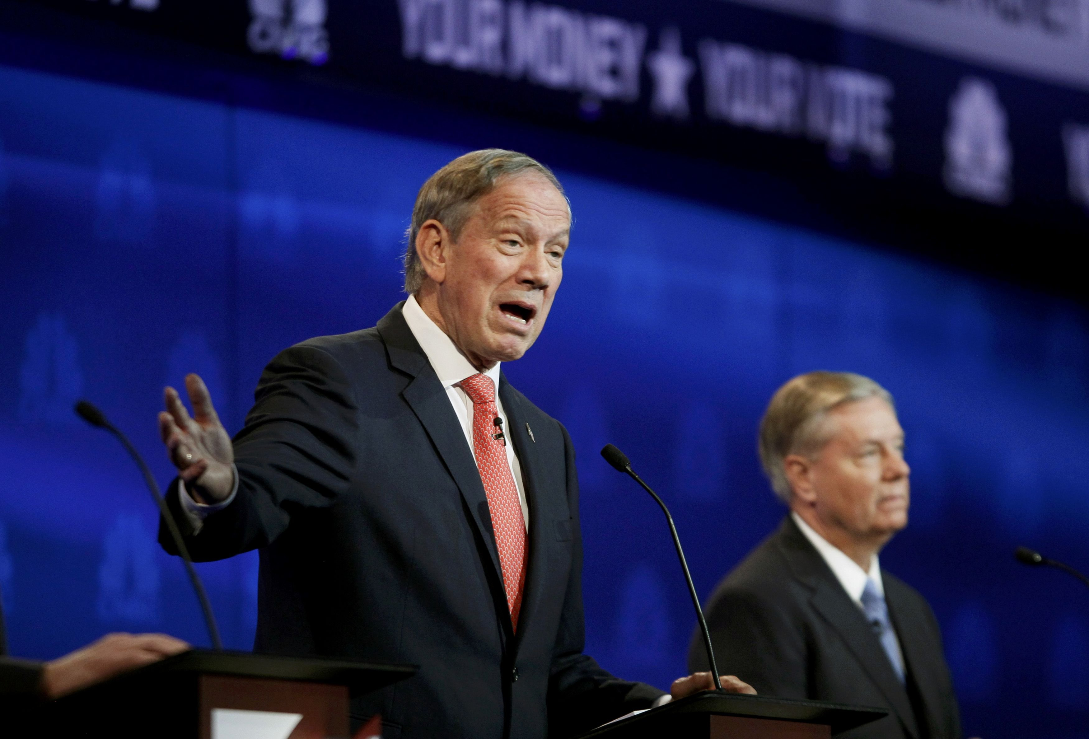 Republican U.S. presidential candidate and former New York Governor George Pataki (L) speaks as Rep. Lindsey Graham listens at a forum for lower polling candidates held by CNBC before their U.S. Republican presidential candidates debate in Boulder, Colorado Oct. 28, 2015.
