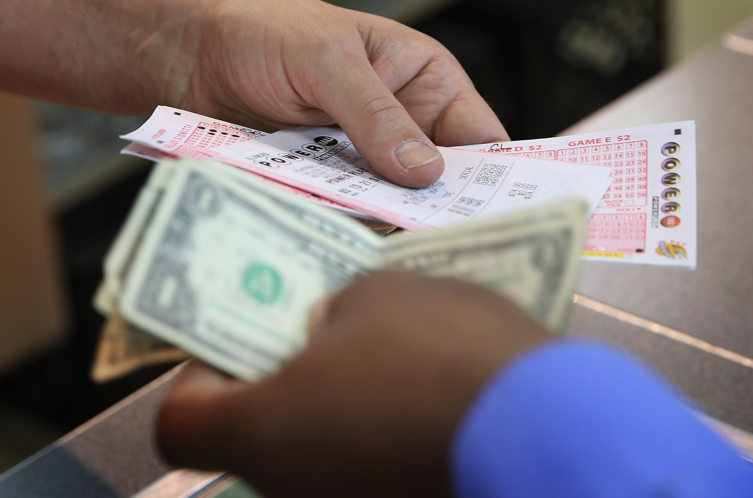 A customer purchases a Powerball lottery ticket on Aug. 7, 2013 in Chicago.